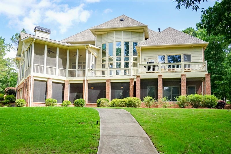 REDUCED $149,500! This finely crafted custom lake home in the Landing at Reynolds Lake Oconee is a must see for luxury lakefront living.  The spacious home has 4 bedrooms, each with its own full bath, plus 2 half baths.  On the main level is a great room/living room, formal dining room, and cozy informal den just off the kitchen.  The terrace level has a large family entertaining area with second kitchen and lower level patio screened full width of the home. Dock is permanent vinyl lifetime construction. A Reynolds Lake Oconee golf membership is available to the purchaser.