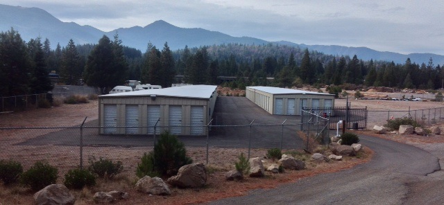 102 modern storage units on 3.4 acres.  Fenced area has plenty of room for expansion. The unfenced area offers plenty of room for various uses including a residence or other commercial uses.  Security gate and cameras.