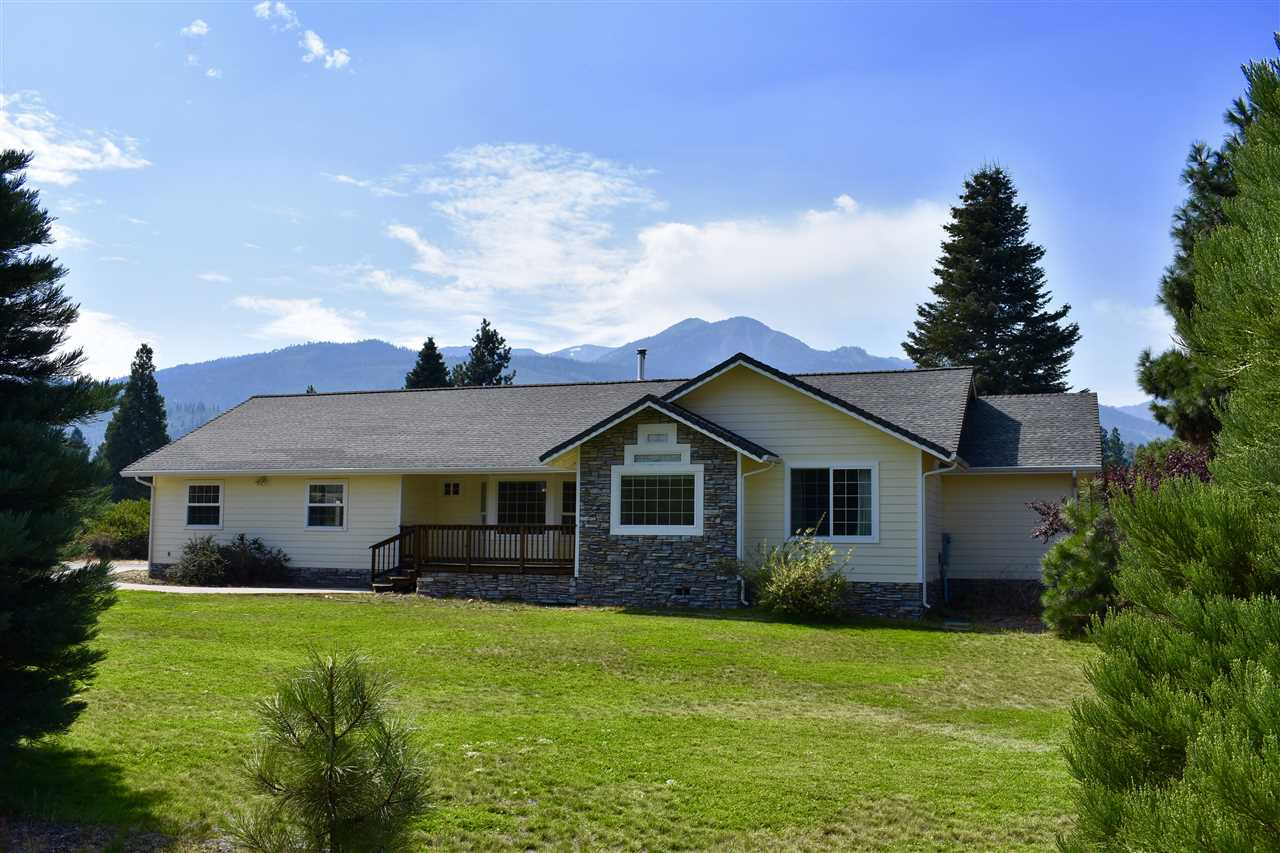 Wonderful home on 2.5 acres. This 3 bedroom 2.5 bath home has a bright open floor plan with vaulted ceiling, spacious kitchen and is great for gatherings. The comfortable master bedroom has a walk-in  closet, large tub, tiled walk-in shower, double sinks and opens to the back deck with beautiful views of the Eddy's. The three car garage has 2 electric doors and offers lots of storage. There is a wood stove and heat pump with air conditioning, private fenced back yard and many more quality features.