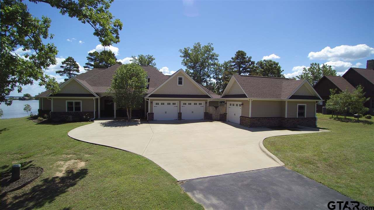 Located on one of the best point waterfront lots on Lake Bob Sandlin, this custom home features all the nice things you desire.  Open living with two living areas.  The primary living area is arranged for your ultimate comfort and convenience.  The gourmet kitchen is very functional and nicely arranged with 8 gas burner WOLF range, granite counters and french style cabinets that will bring out the chef in you.  There are two master suites each have master bathrooms with roomy walk-in showers that feature wet and dry areas.  A 2 stall boathouse features an entertaining area and a deep 17 feet of water when the lake is at normal elevation.  The Peninsulas is a gated lake community populated with nice homes, a group entertaining facility, interior private lake and swimming pool. We could go on forever but the best thing for you to do is see it in person.