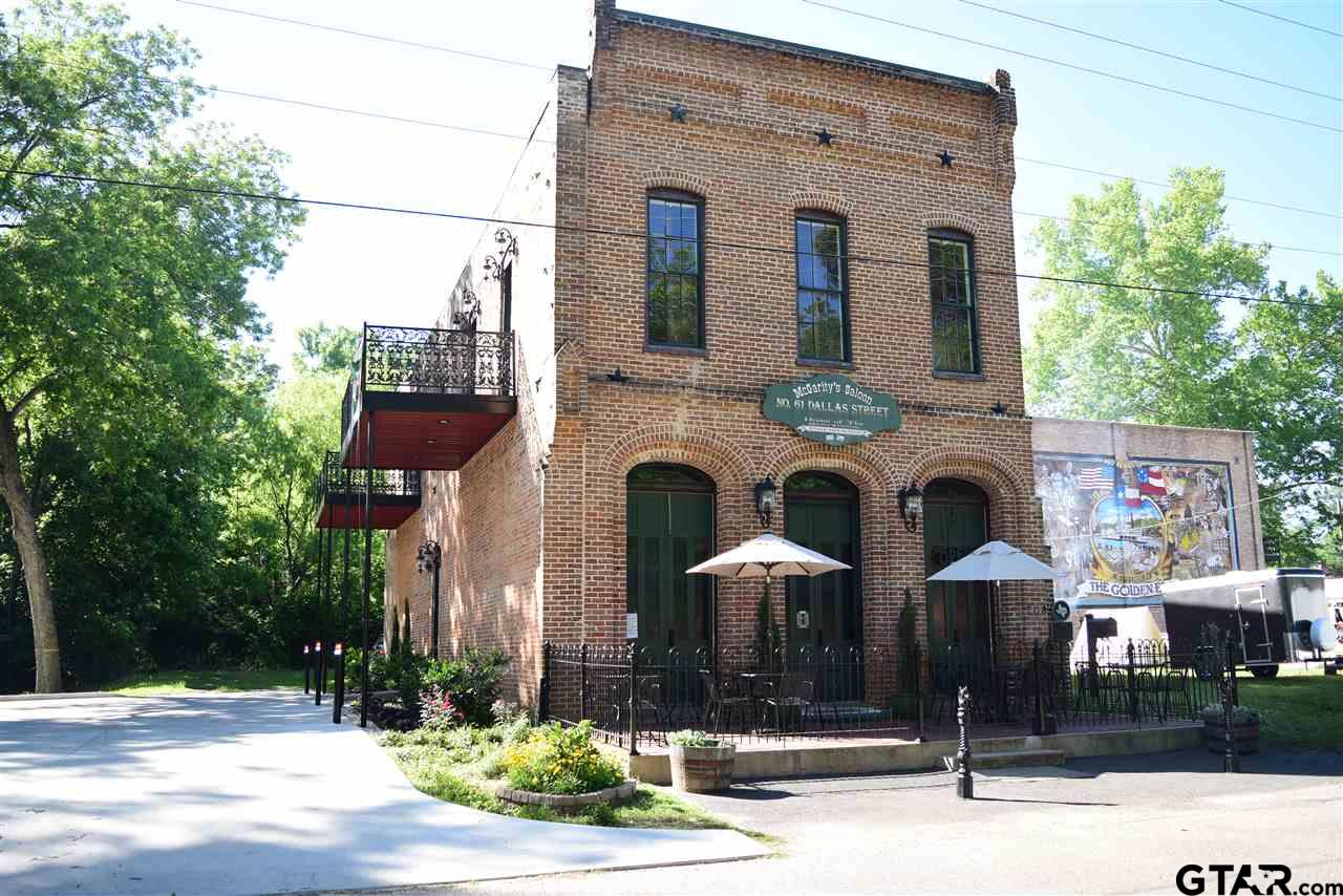 Located in the historical  town of Jefferson, home of the candlelight tour of historical homes, the Texas ghost walk and many other festivals, this 1860s building is less than an hour from Shreveport and only 2 1/2 hours from Dallas. Bottom floor is currently used as a restaurant, but could easily be converted to living area. Take the elevator or the grand staircase to the quaint upstairs residence. Completely remodeled with granite countertops, stainless appliances, tile surrounding garden tub, multi-head shower, hardwood flooring and more, this 2 bedroom, 2.5 bath still has the timely charm of the building. A large patio area accessible thru 2 doors of the living space, provides outdoor relaxation after a long day.