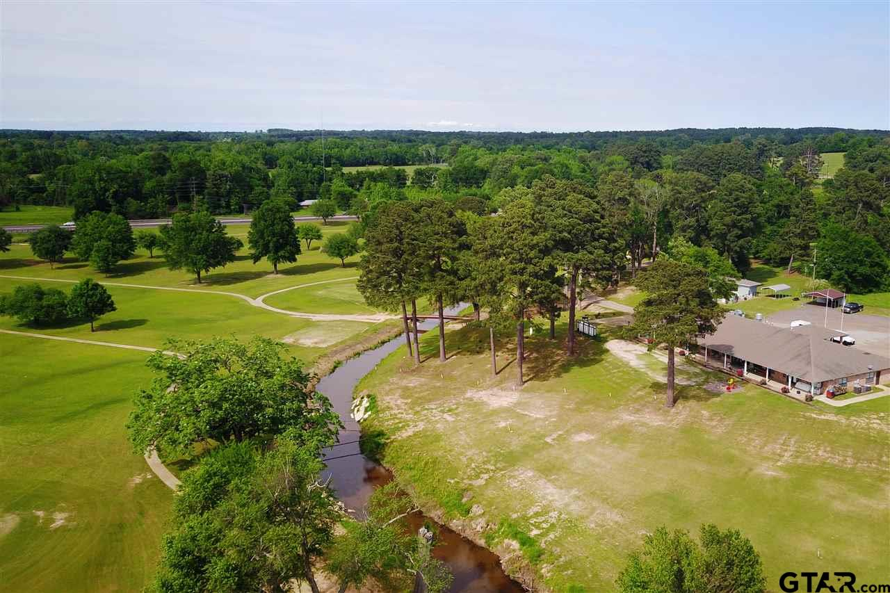 This golf course is a true gem in East Texas and is a wonderful opportunity to own your own course. This is a private golf course with monthly dues (green fees are available) and consist of a 9 hole golf course with multiple tee boxes so plays as an 18 hole course. The different tee boxes allow for different levels of golfers. The Par for 18 holes is 76 and consists of approximately 5,950 total yardages. The newly renovated 6,000 SF Clubhouse has multiple offices, kitchen, ballroom (with full kitchen) and bar overlooking the course. The swimming pool was built new in 2014 and the 40 cart shed were completed in 2015. Maintenance shed on site.