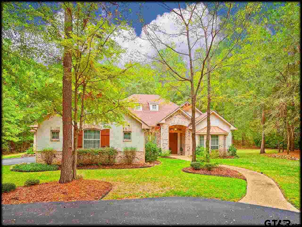 Lovely 2008 Custom Home with Pool near Lake Palestine. Home is located on a 2.88 acre cul-de-sac lot in the Lake Palestine gated community of Pine Ridge Estates, which has 3 stocked ponds for fishing, plus an acre waterfront lot with boat ramp & fishing pier. Handsome Cedar trim accents the 1 story home. Step inside to view the open formal dining space, entry hall, formal living room & study with French doors. Main living area has  15' vaulted ceilings with rustic cedar trusses, corner stone fireplace and is open to kitchen & breakfast areas. Enjoy pool views through 4 sets of sliding glass doors. Kitchen has white custom cabinets, island with breakfast bar, pantry, mosaic backsplash, granite & black appliances. Split master suite has faux fireplace (gas line available in wall) and sitting area. Master bath has jetted tub, shower & large walk-in closet. 2 guest rooms share Jack/Jill bath, 4th bedroom has private bath. 3 car garage. Awesome pool & patio! Jack/3 Lakes/RE Lee schools.