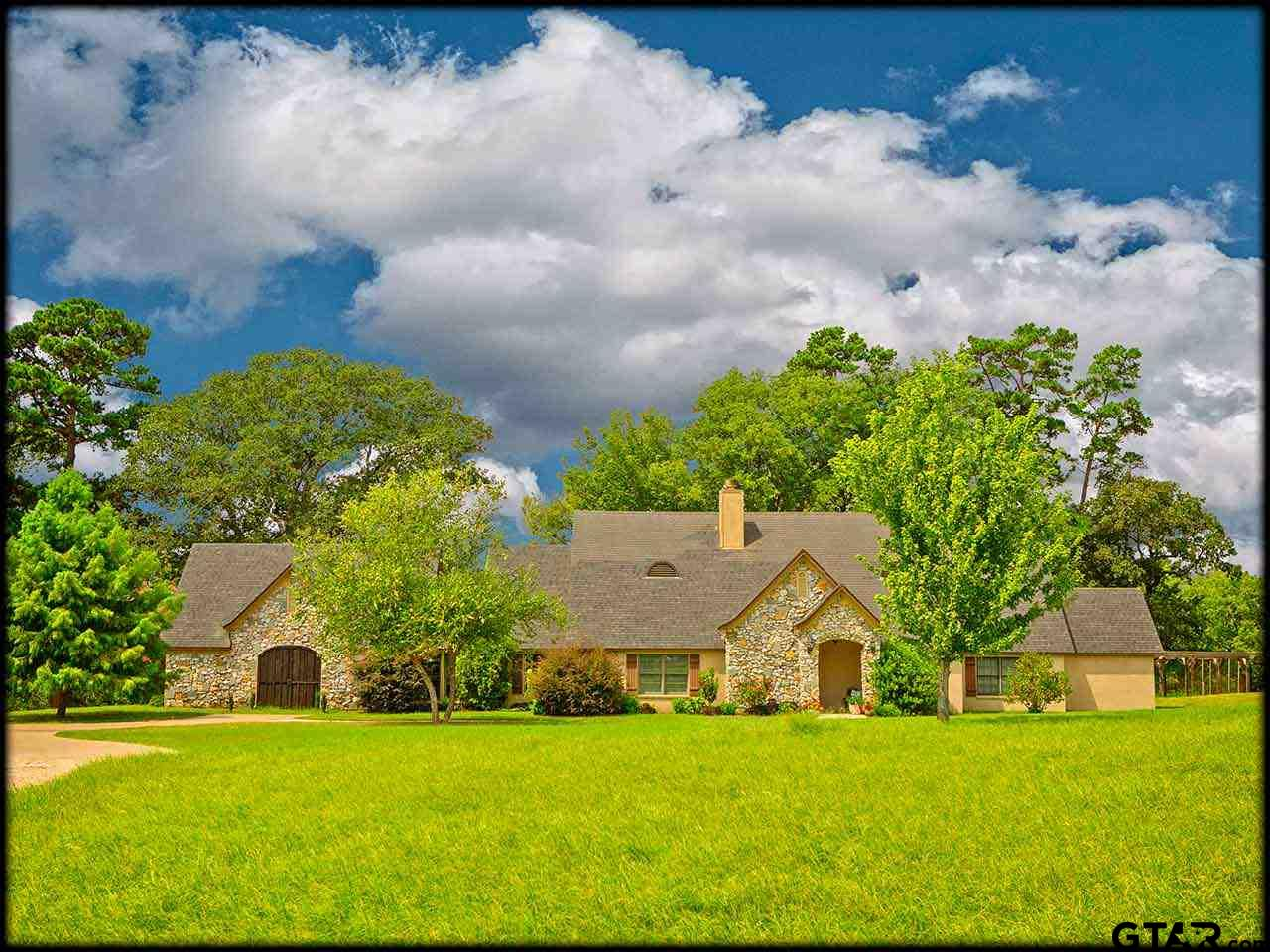Gated 37 Acre Gentleman's Ranch with 40'x60' Shop. Approximately 25 minutes South of Tyler, is an updated 4 bedroom, 4 bath custom home on acreage that is 60/40 coastal pasture & heavy woods. Game & wildlife abound with live creeks & wooded cover. For the Gentleman, the impressive 40'x60' insulated metal shop has 3 overhead doors, 6 windows, RV storage, 200 amp electrical. Stately & inviting home has rear entry 2 car garage with shop area, sun room, formal dining & mud room with fabulous storage. Expansive & open living space has stone fireplace, breakfast area, professional kitchen with Wolf range. Amazing nature views out the kitchen windows! Comfortable master bedroom with walk-in closet, master bath has large shower, corner tub, dual sinks and lovely lighting. 2 guest rooms, 2 guest baths on main floor. Upstairs is private guest suite with living, bedroom & adjoining private bath. Wrought iron fencing & gate with keypad, 1,000 feet crushed concrete driveway. Numerous updates!