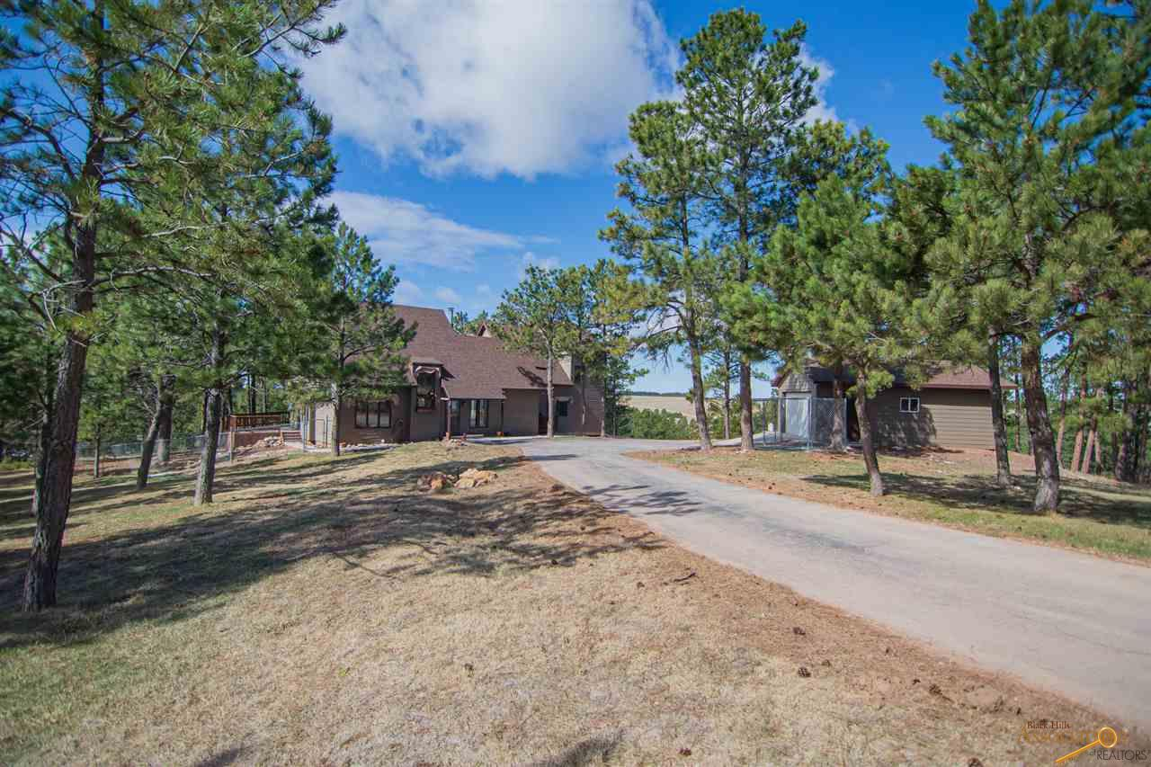 Listed by Will Dixon. Keller Williams Realty Black Hills, 605-390-1140. Are you ready for quiet moments with spectacular sunrises, sunsets and a never-ending view of the stars? Look no further than this spectacular home. Located at the end of the road and not too far from Mickelson Trail, this home is built for versatility. Entertain and cook meals on the outdoor kitchen and eat on the deck. Bring your pets to run around in the fenced yard and an additional dog pen is available. Plenty of bedrooms and bathrooms for everyone. Too cold to be outside? No problem, head downstairs with the Old English pub style and wine cellar. Have to work and exercise? There is room for a gym and readily adaptable rooms for a home office or 2! There is also a huge shop for hobbies and projects. Grow your own vegetables in the 16 bed enclosed garden. When work is done and it's time for play enjoy the wildlife just outside your windows or take a horse or 2 for a ride in the fenced pasture near the corral.
