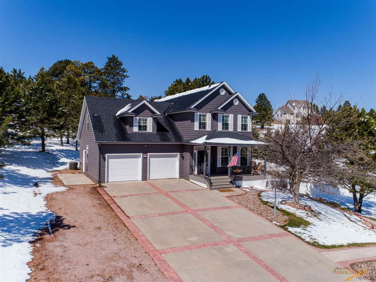 Listed with TJ and Angelica Wojtanowicz at Black Hills Realty 605-863-1920. Beautiful two-story home, nestled on an acre in a quiet cul-de-sac. This home features 5 bedrooms, 3.5 bathrooms, and a 2 car garage with RV parking. There's so much natural light with big windows throughout.  A great spot for getting together, the bright white kitchen with granite countertops walks into a large living room with gas fireplace. Main level also has a formal dining room, plus breakfast dining area, and main level laundry room. Upstairs you will find a master bedroom en-suite with walk-in closet, bedroom with large walk in closet, and a third bedroom with bathroom. The lower level has a large family room with walkout to side patio, and bedroom with bathroom. Great outdoor space with a big fenced yard surrounded by trees. Call today to view!