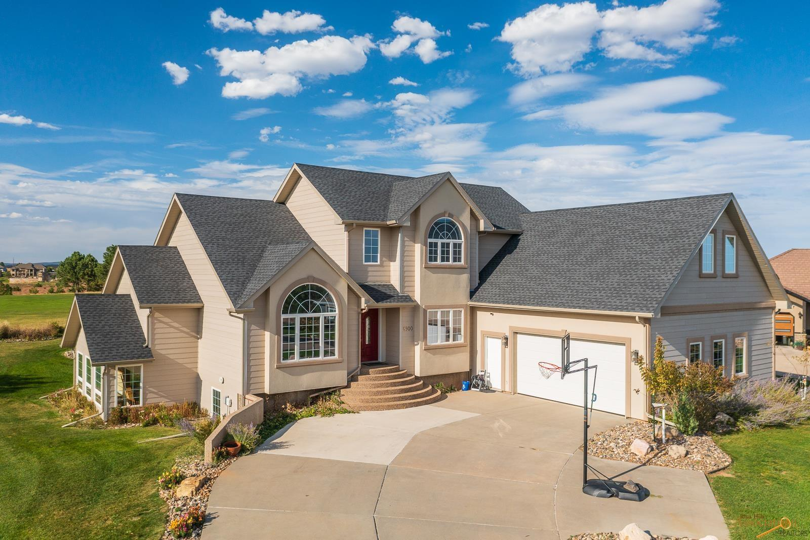 Listed by Megan Mahoney, Assist2Sell Realty (785-304-0570.)  This BEAUTIFUL, 2-story home sits in a quiet cul-de-sac in the coveted Red Rock Estates Subdivision. The 9th and 10th fairways of Red Rock Golf course are right out your back door! This custom-built house features 5 bedrooms, 3 1/2 baths and 5144 sq feet.  Some of the features include a formal dining room, office, butlers pantry, vaulted ceilings, gas fireplace, maple cabinets and granite countertops.  The spacious master bedroom suite on the main level has a walk-in closet, private bathroom with double shower heads and french doors that lead out onto the patio. The upper level has two bedrooms, each with their own walk-in closets, and a large bonus rec room.  Entertain guests in the large family room in the basement,  complete with wet bar, Theater room, full bathroom and walkout to the back!  Don't miss out on this gorgeous house- call to set up your showing today!
