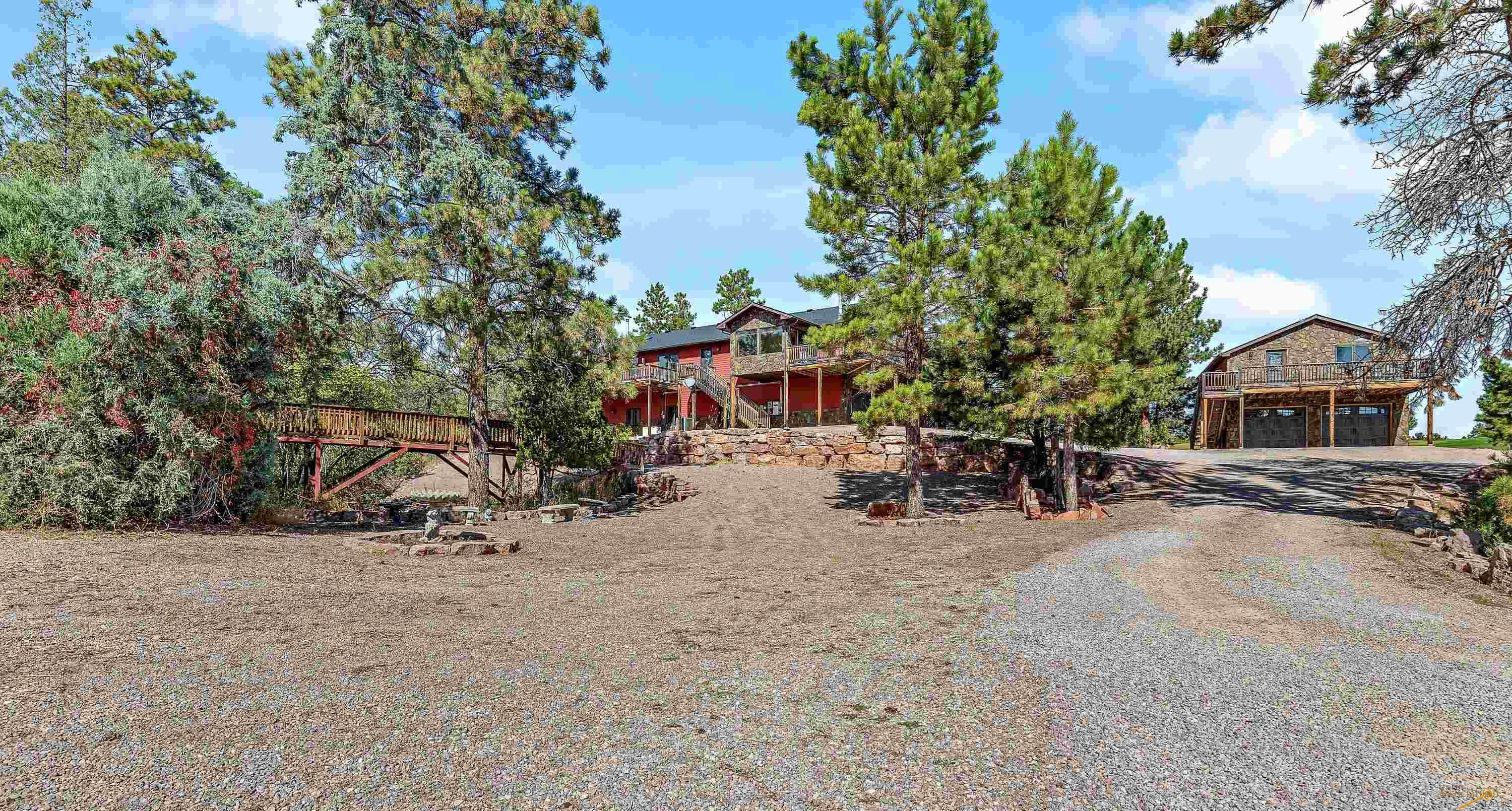 """Here is a Private Lifestyle on SD's Premier Public Golf Course. This builder-owned home is on 1-acre, & situated in a """"V"""" between the front 9 and back 9 of the Southern Hills Golf Course. From this private location you have views of 3 driving ranges & 8 golf holes. +4200 sq ft of decks, including a 33x12.5 heated in-ground pool with LED lighting and 60-inch waterfall, an outdoor kitchen, and a 5-man sauna.  This is outdoor living at its finest.  Open-concept kitchen, living room, dining area, complete with an office & sun room. The large master en'suite has a custom tile walk-in shower, jet-tub, dual sinks, 2 walk-in closets, and main floor laundry.  5 bedrooms total: 2 bedrooms on the main floor & 3 beds in the walk-out basement.  The 4-car attached (drive under) garage is finished, and even has a half bath, and the detached 2-car garage has bonus finished entertainment (great room) space upstairs. Even if golf is not your sport of choice, the area provides an abundance of amenities."""