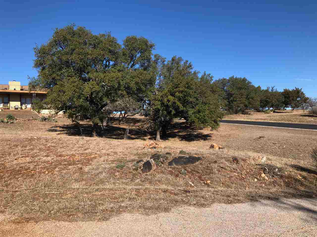Beautiful lot in Horseshoe Bay West featuring breathtaking hill country views looking eastward, across distant hills to magnificent Lake LBJ.  Seller is also selling home behind lot (634 Broken Hills) and 2 surrounding lots. Call agent to inquire.