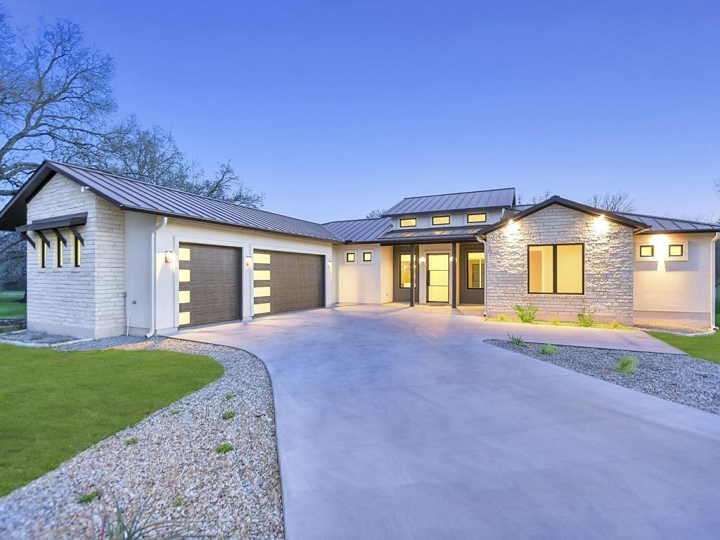 In a woodland setting, centrally located, this luxurious, new construction home is minutes from Horseshoe Bay West's most up-to-date clubhouse, pool, and golf amenity. Surrounded by a sweeping stand of live oaks and offering thorough attention to detail, step into the great room where a bank of windows bathe the room in natural light.  Enjoy tree-shaded views as the fireplace adds cozy ambiance.  From luxurious fare to simple meals, relish the stainless, open-concept, gourmet kitchen where abundant storage, center island, quartz counters, and a walk-in pantry make entertaining delightful.  Drink your morning coffee or lunch at the kitchen's gleaming bar, then move to the formal dining area for a more elegant affair.  A secluded owner suite features a sitting area with picture window, tree-shaded views to the creek, a luxurious en-suite bath, and a large walk-in closet.  The split floor plan makes guest accommodations easy.  Bright, airy guest bedrooms offer custom closets and share a hall bath.  In a private wing, the fourth bedroom provides a dedicated bath.  Energy efficient construction and smart design saves you time and money. An outdoor patio provides natural views and is perfect for winding down after a demanding day on the lake or links. Relax with cocktails and dinner on the covered porch as daylight melts into the colorful evening skies.  Then cozy up with a good book as wildlife visit & night time falls.