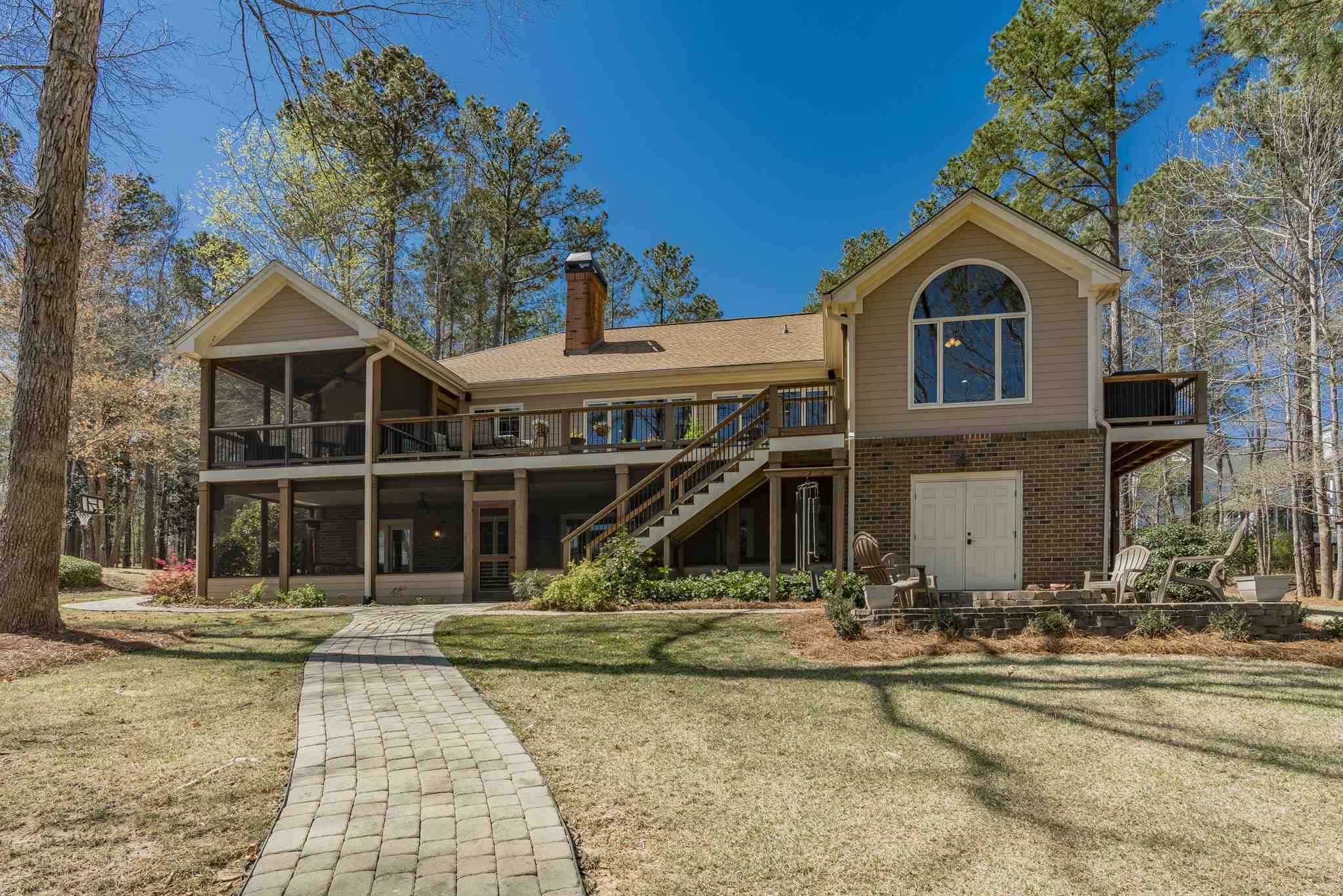 Relax in this newly renovated lakefront home. This 4,311 sq. ft. ranch with full finished basement is the perfect cozy Lake Oconee retreat. Virtually rebuilt and upgraded in 2013 to create a modern open floor plan, the home includes an expanded 2+ car garage and a new Trex max dock. The all new chef's kitchen features all SS Thermador appliances including a 4-burner gas stove, 2 wall ovens, and a wine cooler. There is a separate formal dining room, and also a sunny lakefront breakfast room. A grill-porch off the kitchen makes outdoor cooking convenient. The MasterSuite on the Main Level includes an upgraded bath with free-standing tub, and a private screened porch. The Terrace Level has a great room, 2 guest rooms with en-suite baths, and a gracious screened porch with a hot tub. The home also offers much storage space, and a workshop. A golf membership is available.