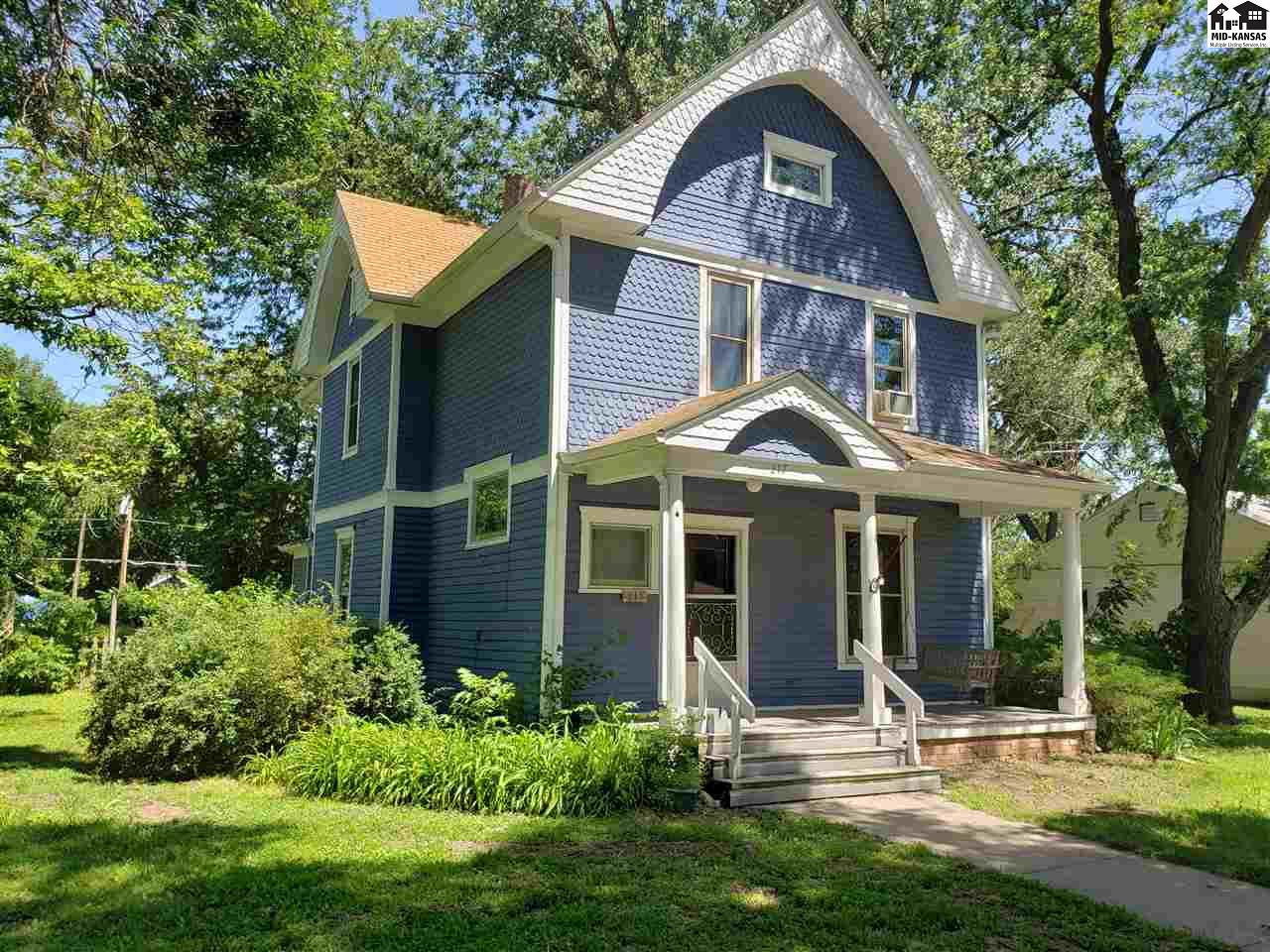 Classically styled two-story home with original features such as woodwork and floors. New kitchen, half bath and pantry. All new double pane vinyl windows. New composite deck on front and back porches.