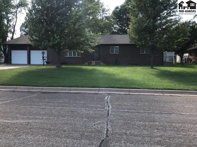 "If living near a ball park, swimming pool and golf course is a dream of yours, look no further.  Not only is the location great, this all brick home is great as well!  Total of 3688 sq. feet and on a double lot. This home sports a nice living room with fireplace, with large front windows to view all the outdoor activity.  Nice formal dining room and an ample sized kitchen which all appliances will remain.  An additional ""sun room"" was added on and is absolutely beautiful.  Master bedroom is large and includes a master bath; there is two other bedrooms and a complete bathroom on the main as well.  In the basement is a family room, another recreation room and 3 bonus rooms and a full bathroom.  There is two outdoors sheds, underground sprinklers, brand new roof, RO water system and a soft water system that is owned and stays with property.  Many other items to numerous to mention.  This is perfect for large or growing family.  Check it out soon."