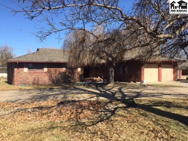 Great location in estblished nieghborhood.  Spacious home with open floor plan. 3 bedroom, 2 bath main floor laundry room. Kitchen has an eating bar and kitchen dinning, formal dinning has a woodburning fireplace and hardwood floors and opens to formal living and main floor family room. The familyroom has a wood burning fireplace vaulted ceilings and leads out to the patio and fenced back yard. Homes sits on an ample corner lot.