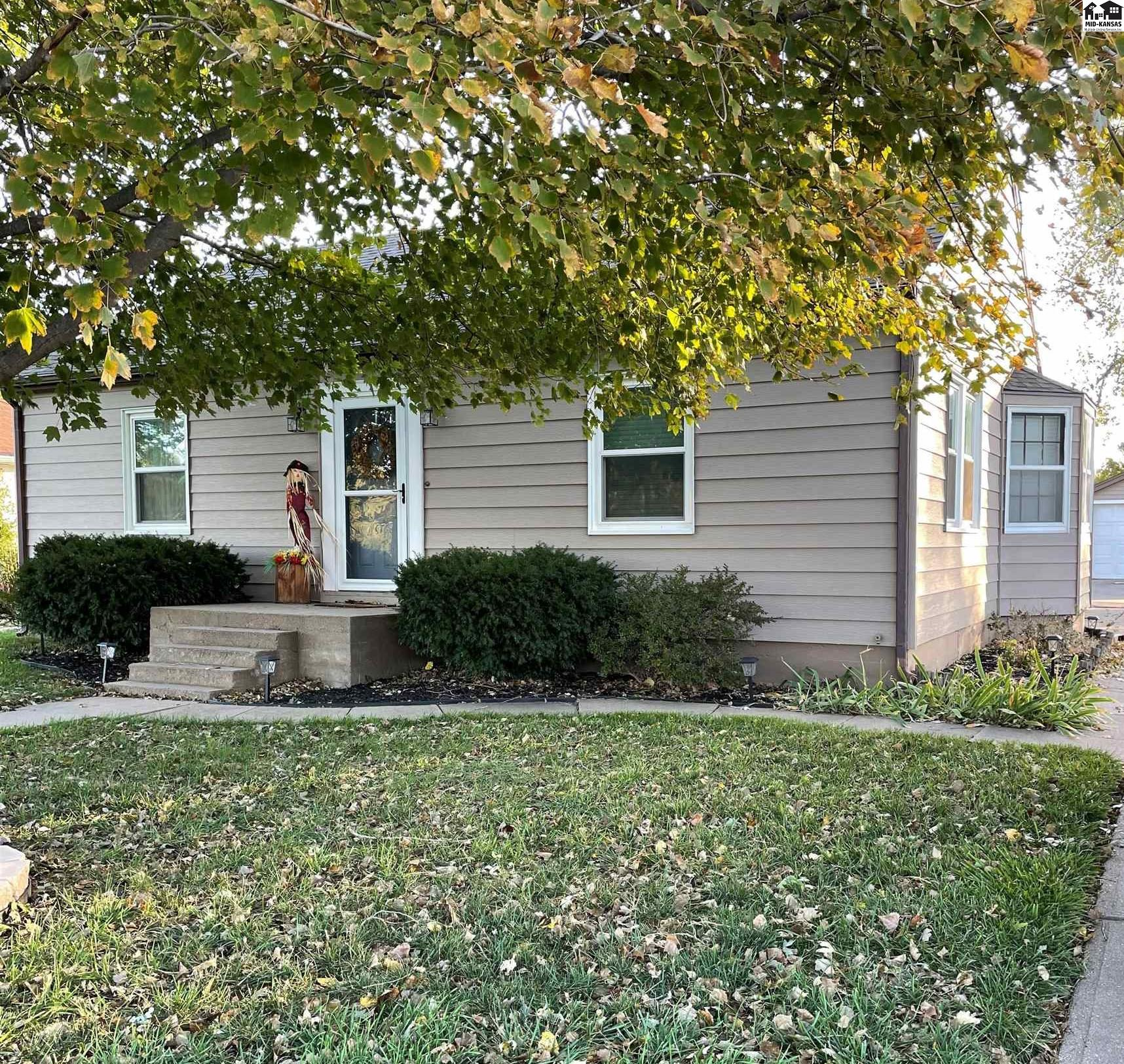 Come check out this beautifully finished 3 bedroom, 2 bath house. Updated color pallet, with white trim, white wood blinds, and new windows in living room and front bedroom. Basement was gutted and finished with a bonus room and family room. Large kitchen has french doors that lead out to a covered patio and fenced in backyard. Large detached 2 stall garage with a shop area at front of garage.