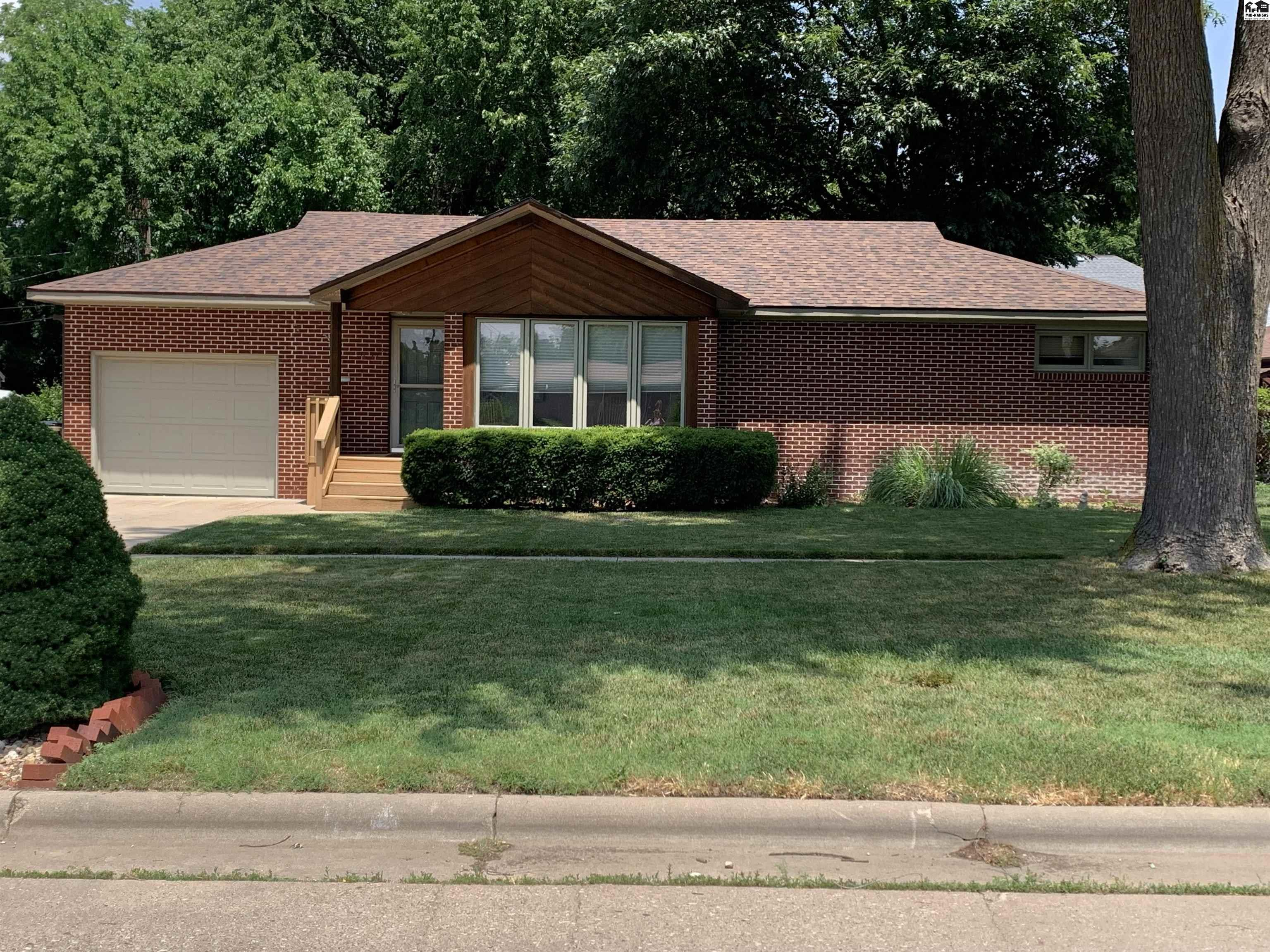 This nice all brick ranch style home is maintenance free, plus just put on new Impact Resistant shingles on roof and new guttering too!  Underground sprinkler system adds to the ease of lawn care.  The back yard is fenced in with a natural gas plumbed-in grill and 220 wiring for a possible addition of a hot tub.  Interior is just as nice.  2 beds, 1 bath (was updated in 2018) on main floor, with formal dining room, a cute kitchen tucked in the center of the home with nice bar area for informal eating.  To finish off the main living is a large living room hosting a large fireplace which has been converted to a gas log but could be switched back to wood-burning.  Basement sports 2 nice bonus bedrooms, 1 updated bath and a nice family room,  Laundry room is also located in the basement.