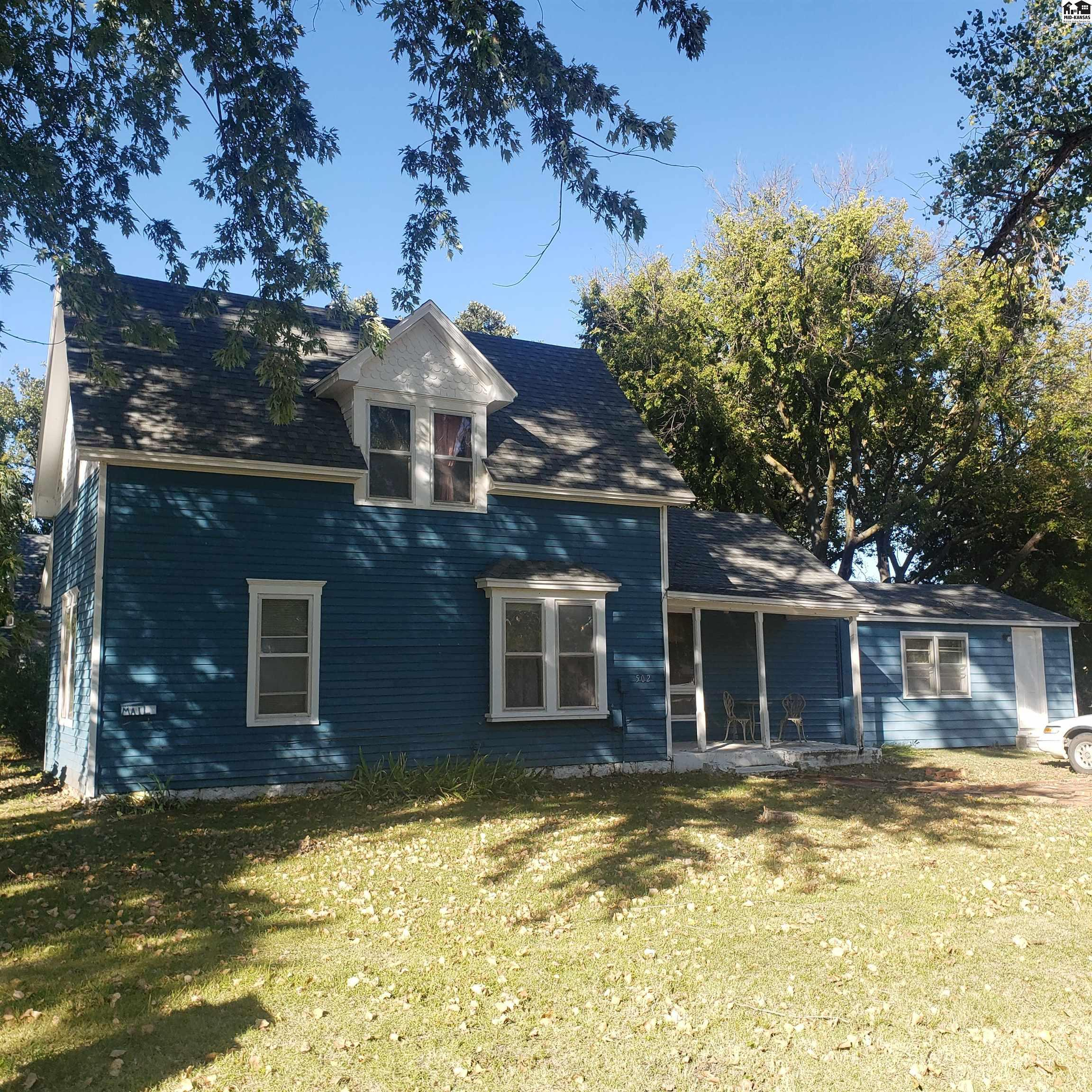 With so many great updates, you wont want to miss making this newly listed 1 1/2 story your own! It sits on a large tree shaded lot with ample room for a future outbuilding or two with alley access. The garage was converted into a master bedroom, but could also be a great bonus space on the main level. There are great sightlines throughout the eat-in kitchen, spacious formal dining room, and living room. Main floor laundry just off the kitchen has some added insulation around the door, and homeowner hung additional plastic on the remaining walls, but they can be moved aside for inspections. The second floor houses the additional 2 bedrooms, with the closet of the green room located just outside of the door. Updates include: 2007-2010 -New roof -Home was weatherized with foam insulation throughout. During the hottest months, electric has been around $200, and in the coldest months, the gas has been around $100 with the single homeowner.  2015 -New A/C motor and parts plus thermostat 2017-2019 -New paint in bedrooms, bathroom, hallways, kitchen, and the exterior -New laminate wood flooring and carpet on main level -New custom fit insulated exterior door and stairs for the main floor bedroom 2021  -New furnace motor