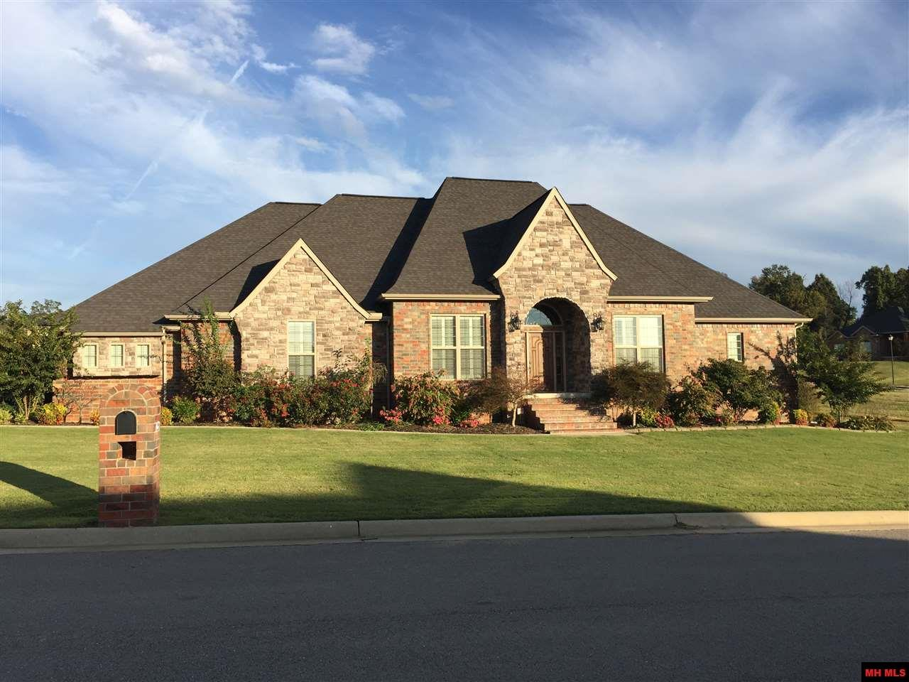 BEAUTIFUL CUSTOM STONE/BRICK HOME in desirable Big Creek Golf Community. Built in 2011, w/extensive upgrades since 2017, this spacious home has 4 BR, 3½ BA, covered patio & a lg yard ready for a pool or kid's play area. Lg chef's kitchen has custom cabinetry, DCS gas cook top & SS appliances. Spa-like master bath w/heated floor & huge closet w/custom built-ins. Open floor plan w/12' ceilings, gas fp, main floor office & bonus rm upstairs w/wet bar. 3-car garage, security system, sprinkler system & storage.