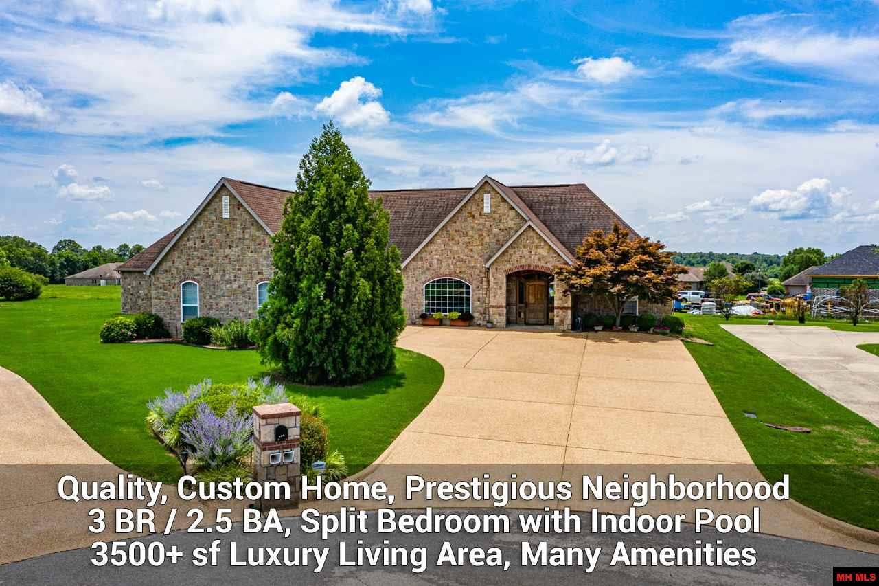 EXCLUSIVE LUXURY LIVING IN PRESTIGIOUS BIG CREEK, CUSTOM QUALITY 3500+ sf  SPLIT BEDROOM HOME WITH INDOOR POOL. 3 BR / 2.5 BA, 2 Car gar. Stone exterior, raised tray ceilings, recessed lighting, upscale custom cabinetry, built for comfortable, spacious living. Every detail of design, construction and finishing carefully selected. Tastefully decorated. Features great room & custom gourmet island kitchen w/6 burner gas stove, 2 dishwashers, stainless high end appl. steamer, warmer, ice machine, walk-in pantry, prep-kitchen & more. Covered patio features ceramic cooker, wolf gas grill & sound system. Master suite has 2 vanities, accessible shower, huge walk-in closet. Indoor pool/exercise room w/endless pool, sauna, garden tub. Laundry room w/sink, storage. Sound system throughout home. 2 Geo-thermal heating/cooling systems, landscaping, irrigation. Peaceful cul-de-sac near Golf Course, Clubhouse & Restaurant. Near shopping, medical, restaurants, White River access. Mountain Home Schools.