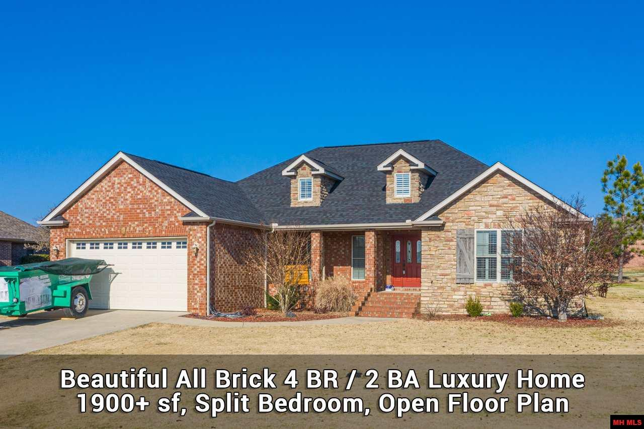 ALL BRICK & STONE LUXURY HOME, 4 BD, 2 BA, SPLIT BEDROOM, OPEN FLOOR PLAN, MANY EXTRAS, BUILT 2007, MOVE-IN CONDITION, DESIRABLE LOCATION. The great room surrounds kitchen w/tiled dining area, large living area, breakfast bar & nook w/bay windows. Perfect for family, friends, entertaining. Convenient kitchen has solid wood cabinets, solid surface counters, tile floors. Luxury master suite has tray ceilings, private bath & dressing room, separate jetted tub & shower, oversize double vanity, large walk-in closet w/built-in shelves, heated tile floor, & more. Three bedrooms & guest bath offer plenty of room and privacy. 2 fireplaces w/gas logs. Covered porch in front with room to relax. Covered patio in back for grilling, outdoor dining. Located in desirable Big Creek Golf & Country Club community featuring 5 star rated premiere golf course. New roof in 2020. Near shopping, restaurants & medical offices. Minutes to Norfork & Bull Shoals lakes, famous White River. Mountain Home Schools.