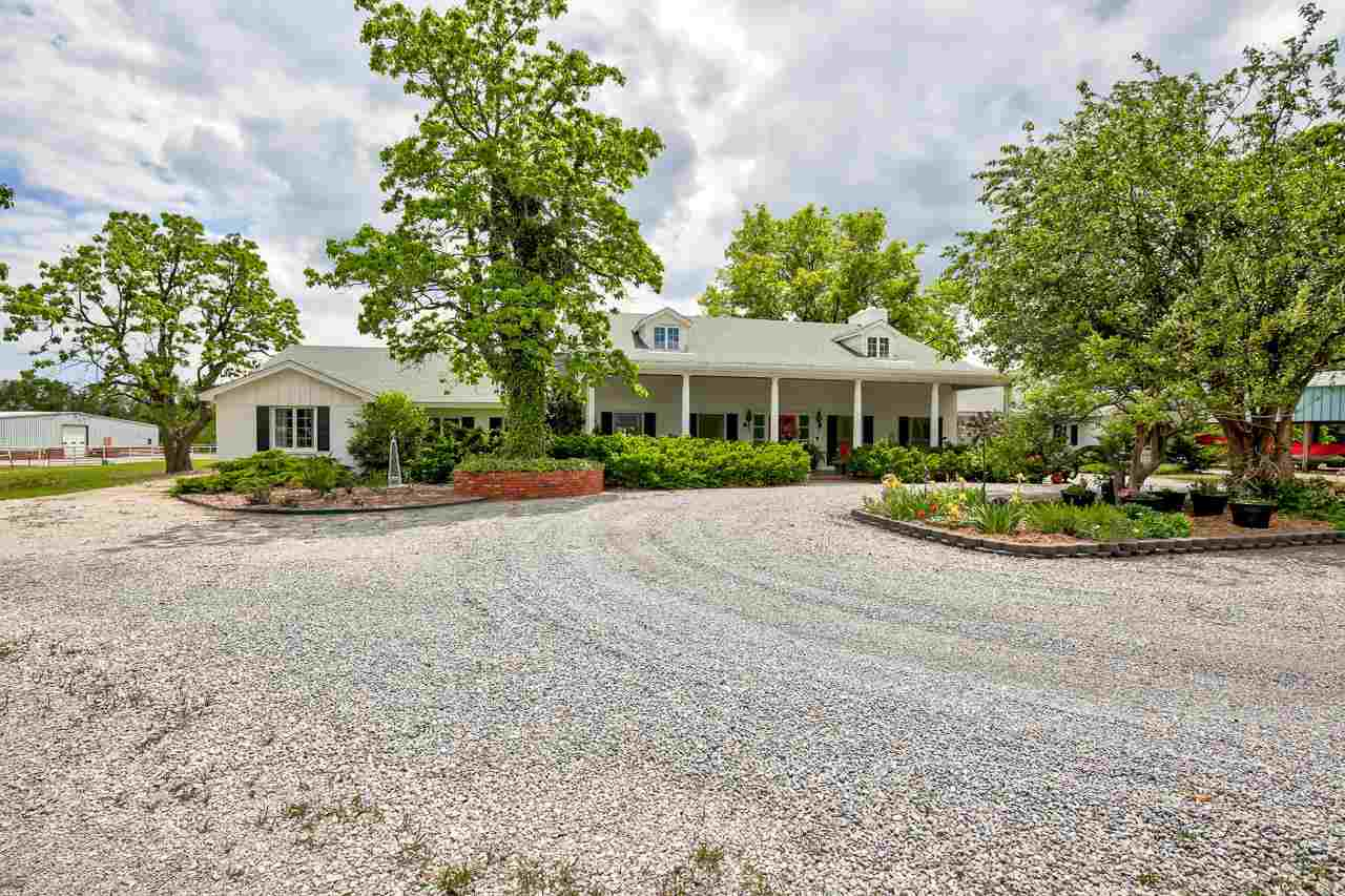 MUST SEE...Beautiful IS AN UNDERSTATEMENT.... ALMOST COMPLETELY remodeled  in 2018. This home  is  one of a kind in the heart of Enid.   4.64 Acres with space to breath... Gourmet Kitchen, with tons of storage.  Wide open view of back acreage.