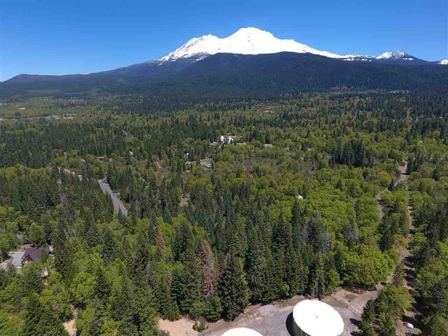 EXTREMELY RARE FIND! Whether you are an investor, developer, non-profit, or someone just looking for a pristine property for their dream home, this land is just right for you! This acreage is so unique because of it's complete privacy, diverse views which includes gorgeous Mt. Shasta, Eddies, downtown Mt Shasta and even Lake Siskiyou! It has a flowing creek, a great well, several options for building sites, various species of mature trees including dogwood, oak, cedar, etc.  PLUS it's just a few blocks from downtown Mt Shasta and amenities. Reference the tentative parcel map for a 4 parcel split + a remainder and turn this land into an upscale subdivision, OR build what could potentially be the most EXCLUSIVE Mount Shasta retreat/home in our area. You could also preserve its natural beauty and diversity for all to enjoy by creating trails and monuments for the community to enjoy. The choice is yours, don't miss out on this great piece of land in Mt Shasta.The possibilities are endless!