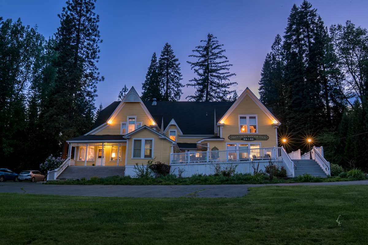 Here is your chance to own a piece of history in the quaint lumber town of McCloud, California. Built in 1903, the McCloud River Inn housed the former headquarters for the McCloud River Lumber Company, McCloud's first bank, and the local Telephone Switchboard. In 1990, the McCloud River Inn received its historic designation by the State Office of Historic Preservation. Currently operating as a Bed and Breakfast, this charming property boasts 5 unique guest rooms, several retail/office space rental opportunities, an innkeeper's apartment, a large event/conference room, lush landscaping, a large sun deck, large storage/garage space, and plenty of room on the grounds for weddings or events. Several old bank vaults, safety deposit boxes, and even an old phone booth make up some of the historic features you'll find within the building. The Inn is within walking distance of historic Main Street in McCloud, where you will find restaurants and shops and numerous local events. Enjoy endless recreational opportunities including hiking, boating, fishing, skiing, and so much more. Take in all of the historic beauty and great income potential that the McCloud River Inn has to offer.
