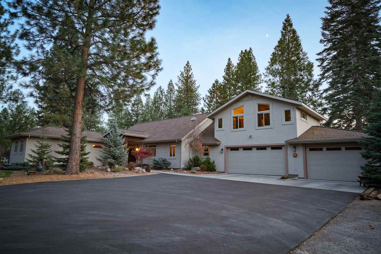 Welcome to 1211 Hidden Meadow Drive!  This 2600 plus Sq. Ft. custom home situated on 2.5 acres in the desirable Hidden Meadow Subdivision offers a beautiful and highly desirable floor plan with modern finishes.  Spacious rooms, and a spectacular view of Mt. Shasta through a wall of picture windows.  The great room boosts a cozy slate fireplace, wood beams, vaulted ceilings that offer peace and tranquility with an abundance of natural light. The well designed kitchen shines with tile countertops, custom cabinetry, and stainless steel appliances with ample amounts of storage. The generous master sports natural light from well placed windows, large walk in closet and access to a patio ready for a hot tub, and all of the natural beauty that the property offers. Office / study. Two upstairs bedrooms ; one with large walk in closet, and one with a roomy balcony looking out into the trees surrounding the home. The two lawns are ringed by colorful landscaping. Oversized 3 car garage that has one third of it set up for a hobbyist dream, hickory cabinet, wood blinds, custom built work surfaces ready for a variety of uses.