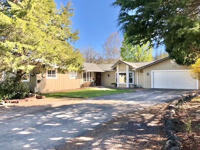 Beautiful home outside of Yreka city limits located at the end of the road with over three acres of usable property. This property has it all!!! The home has been tastefully remodeled with updated flooring, bathrooms, and an open kitchen with granite countertops. The home offers a living room, dining room, breakfast nook, family room, three bedrooms, and two bathrooms with over 2100 sq ft of living space. There is ample room for your animals including a barn, and fenced pasture area. The home has an attached two car garage and a large shop with plenty of storage. There is also a carport tall enough to store your RV with full RV hook ups. The beautiful landscaped yard offers a full sprinkler system for the entire 3.27 acres of property, and a seasonal creek. The covered back porch has plenty of room to entertain your guests and enjoy the Mt Shasta view from your backyard while playing a game of horseshoes or warming up by the fire pit. This home is ready for its new owners. Come and take a look today you won't be disappointed.