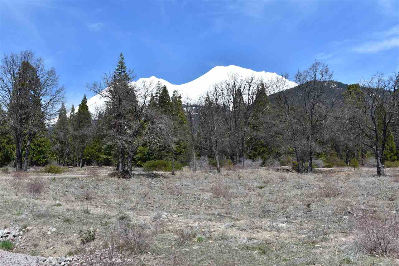 Outstanding views of Mt Shasta and the Eddies. This lot sits on over 3 acres of desirable property, and is ready for your dream home to be built. The property has been cleared and beautiful oak trees are located throughout the property. This property is located in a gated community just outside of city limits with paved roads and underground utilities. Come and take a look at this property with its breath taking panoramic views.