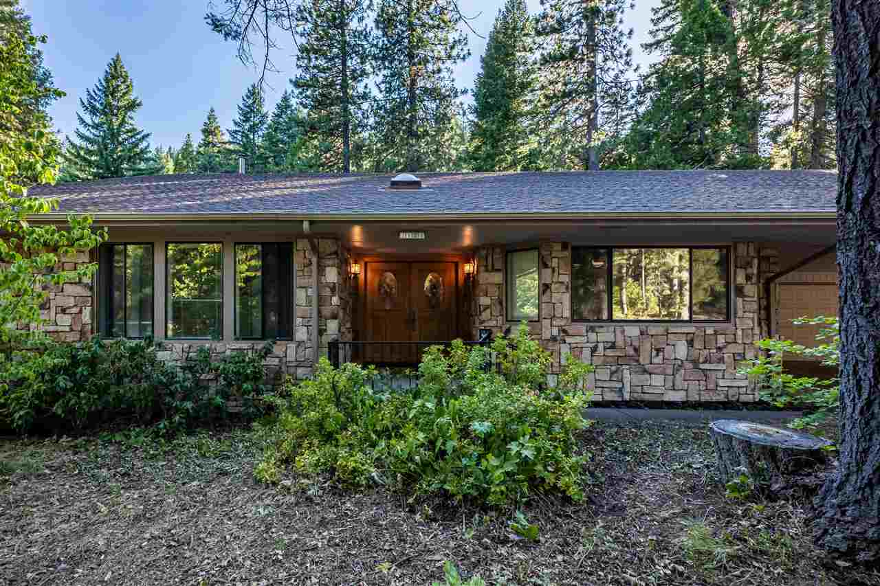 Welcome home to 2121 Tanager Lane! Nestled in the Timber Hills Subdivision, this special home sits on a large lot with towering trees and a peek-a-boo view of Mt. Shasta. The front of the home is graced with rock siding and leads you into a open and spacious living room. This home provides you with a tile entry, large formal dining room and the living room that boasts an atrium, rock hearth with free standing fireplace and a large picture sliding glass door leading to a patio. The spacious kitchen features copious amount of cabinet space, tile counter tops, gas range and double ovens.  Off the kitchen is a  walk-in pantry, offering you plenty of room for all the essentials.  This home also sports 2 master bedroom suites, with jetted tubs and tile counter tops.  One of the master suites leads to a covered back porch with hot tub, perfect for outdoor entertaining.  Other exciting features of the home are skylights, office/bedroom with French doors, large covered carport attached to the oversized garage, and an enclosed breezeway between the large utility room and garage.   This home has it all!