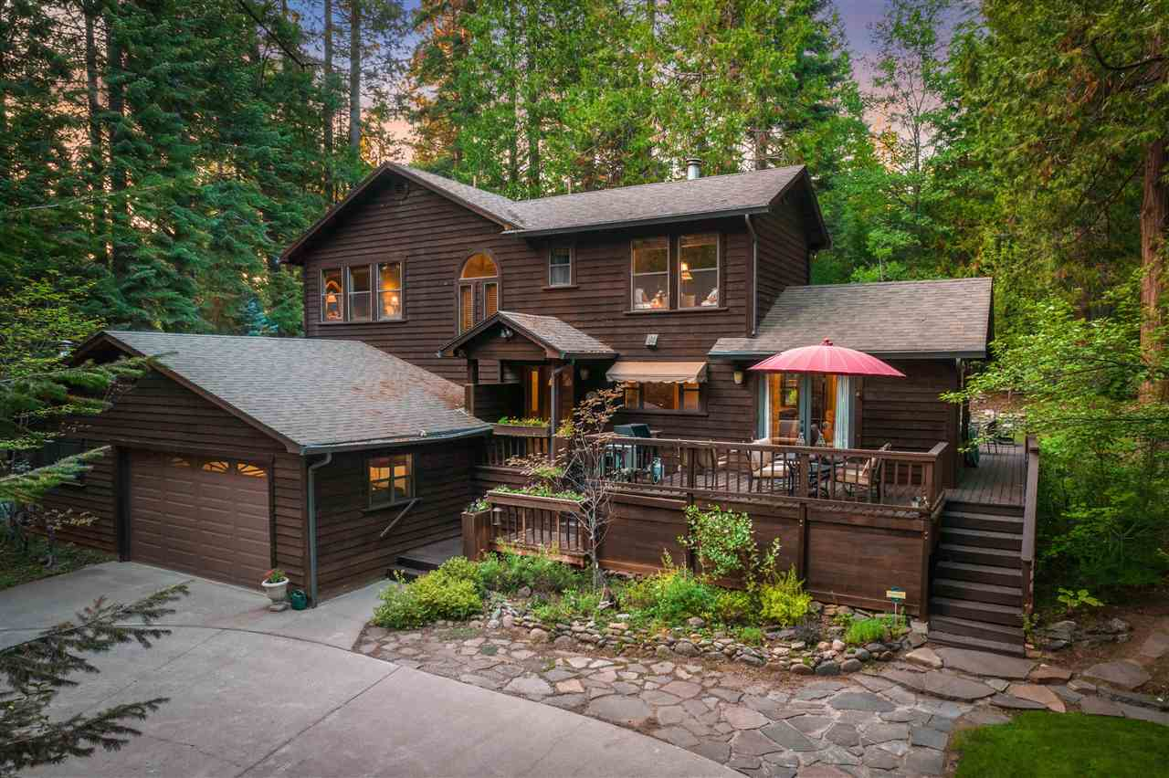 This home settled into large mature oak and fir trees will ensure solitude and privacy.  The flowing design enhances luxury mountain living and offers intimate spaces to relax with family and friends.   The exquisite architecture features an amazing living room with large wood beams, stunning rock hearth with beautiful wood mantel and picture windows. The breathtaking kitchen offers gorgeous custom cabinets, six burner gas decor range, copper kitchen sink, and granite counter tops. In addition,  this home sports wood blinds, fir trim around windows and doors, ceiling fans, and a fabulous cozy office space or craft room off the garage.   This amazing home offers expansive outdoor entertaining areas with large wood decks, spa, RV parking, and garden area.  Come and enjoy the unique character where art and function are joined as one in your ultimate mountain experience. Convenient access to downtown Mount Shasta, Mt. Shasta Board & Ski Park and Lake Siskiyou.  Buyer should verify parcel size.
