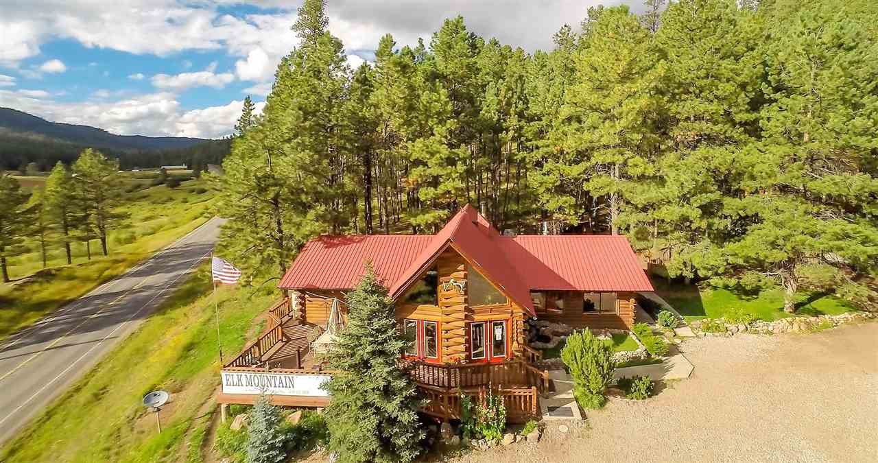 GREAT OPPORTUNITY!! Nestled in Jemez Mountains is lovely custom home on 3.3 acres. Current owner is using as a Bed and Breakfast. Main house is over 1500 sq ft w/ 2 master retreats and 2 ensuite spa type baths. Beautiful flagstone floors, radiant heat. Upstairs loft can be used as an office or bedroom. Natural log walls and knotty-pine ceilings. Floor to ceiling windows bring abundance of natural light. Outdoor deck with BBQ and wood-burning kiva make a perfect gathering place w/ panoramic views winter or summer. The fully furnished cabins can be used as a AIRBNB, B&B, long term rentals, hunting and fishing cabins. Possibilities are endless for additional income! Enjoy the hot springs, Valles Calderas,Village of Jemez Springs. See additional attachments. Please call for income statements LO/SO Remarks: Please schedule showings with listing agent Roberta Chavez 505.379.2293 with 24 hour notice.