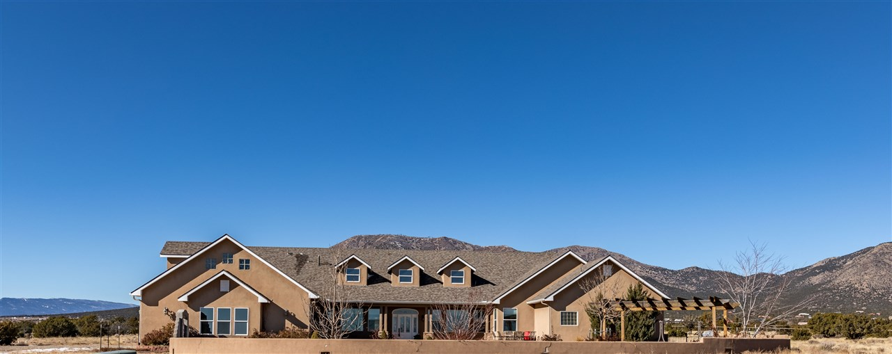 This luxury custom built Edgewood, New Mexico country home sits on 10 acres in a small gated subdivision that offers privacy and expansive Sandia Mountain and Estancia Valley views.  I40 is less than 10 minutes away for an easy 30 minute commute to Albuquerque. Santa Fe with its culture and exquisite restaurants is less than an hour away.  The home's spacious great room is central to home life activity and features a sun room with a wet bar and a media room setup for theater seating. The dining room offers magnificent views of South Mountain and, as a bonus, the dining room table and hutch are included in the purchase. Everything in this kitchen is top-of-the-line from cabinetry to the appliances and granite counter tops. There is a large walk-in pantry, and sunny breakfast nook. The master suite has it all with a beautiful master bath that includes a jetted tub, large shower, double vanities and his/hers walk-in closets. Just off the master suite is a private office and a dressing/workout room. The front yard is beautifully landscaped and offers a fun place to entertain. The home is on natural gas, a private well and septic system and a public electric co-op system. This home is one-of-a-kind and is not to be missed.