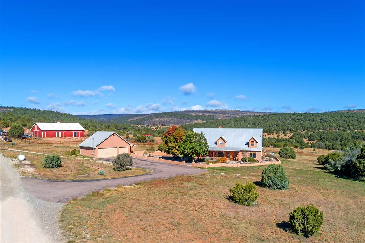 This gracious 4 bed, 3 bath mountain home and turn-key equestrian facility with ample barn, hay storage, pipe-fenced arenas and grazing areas is sited on 308 acres and is bordered to the west by the Cibola National Forest.  Situated in the beautiful Manzano Mountains, the heavily forested property gives a feeling of privacy and seclusion, all while being only 45 minutes from Albuquerque and about an hour and a half from Santa Fe.  This property is surrounded by and steeped in New Mexico history, being located just off of the historic Salt Mission Trail, which was used as a trade route connecting 13 communities in central New Mexico.  Also located on the property is one of the original homesteads in the area that was likely built in the early 1920's.  With some work, the thick adobe walls and two large, open rooms of this homestead structure would make for a fantastic guesthouse, caretaker's quarters or artist studio!