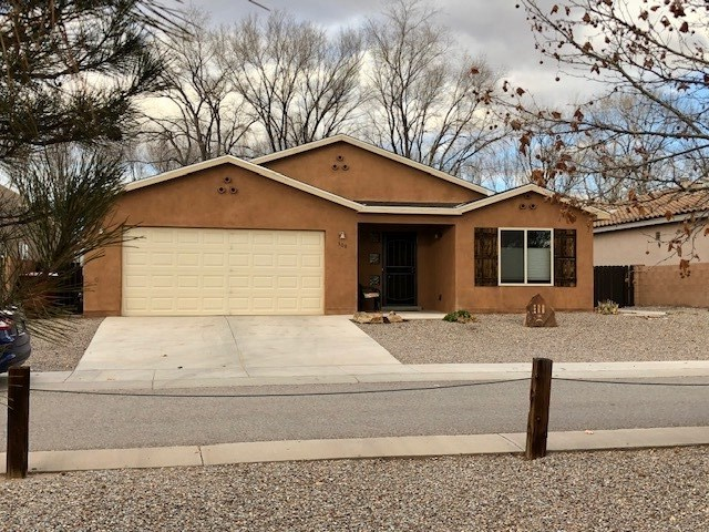 This home has it all --- comfort, convenience, economy! Comfortable, nearly new (built in 2015) 3 bedrooms, 2 baths, den, and living/dining/kitchen Great Room, with sliders to an enclosed patio room overlooking large outdoor patio garden area. LOCATION! convenient Damiano Square Subdivision within walking distance of the Rail Runner - ECONOMICAL with PV solar panels on roof. Gorgeous stone-faced remote-controlled electric fireplace. Cathedral ceilings throughout this contemporary beauty. Incredible kitchen appliance collection: RETRO 1950's Reproduction Appliances - stove, refrigerator, range hood, even the microwave! (Note: seller will exchange or make allowance if buyer doesn't want 'Retro' appliances). Enjoy wonderful Sandia views and sunsets from the oversized windows in the den.