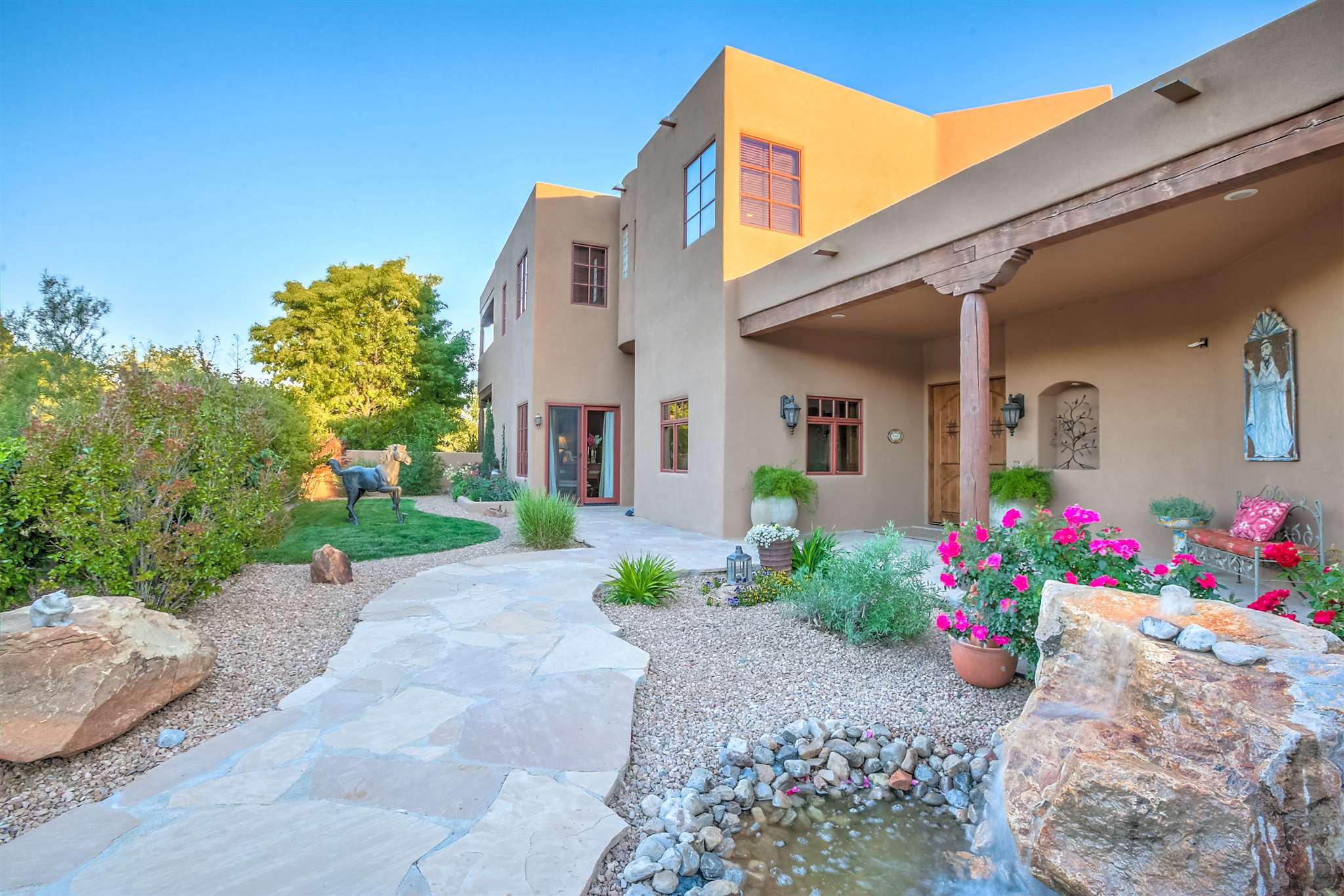 Beautiful, warm and inviting custom Pueblo-style home on one gated, fenced and landscaped acre. Enjoy the centrally located Corrales greenbelt location on Caliente De Sol - a Private cul-de-sac off of Cinco Milagros and Price Lane. Lovely mountain and colorful views from the strategically placed oversized windows which fill the home with abundant natural light. Fabulous knotty Alder cabinetry, tall ceilings and storage galore! A Chef's kitchen features double ovens, warmer, oversized pantry, appliance cabinet, large kitchen island and separate entertaining wet-bar. Great floorplan with indoor outdoor conversation areas. Four bedrooms include large walk-in closets. Four bathrooms. Discreet, heavy-capacity private elevator for multi-generational living. OVERSIZED three door finished garage with extra deep capacity, height and separate toilet availability. Double up the car capacity, or enjoy the extra hobby/workspace. Upgraded finishes, radiant heat, forced air heat, refrigerated air and security system. Private well, and septic. zoned A-1.  Bring your furry friends, chickens and equine.