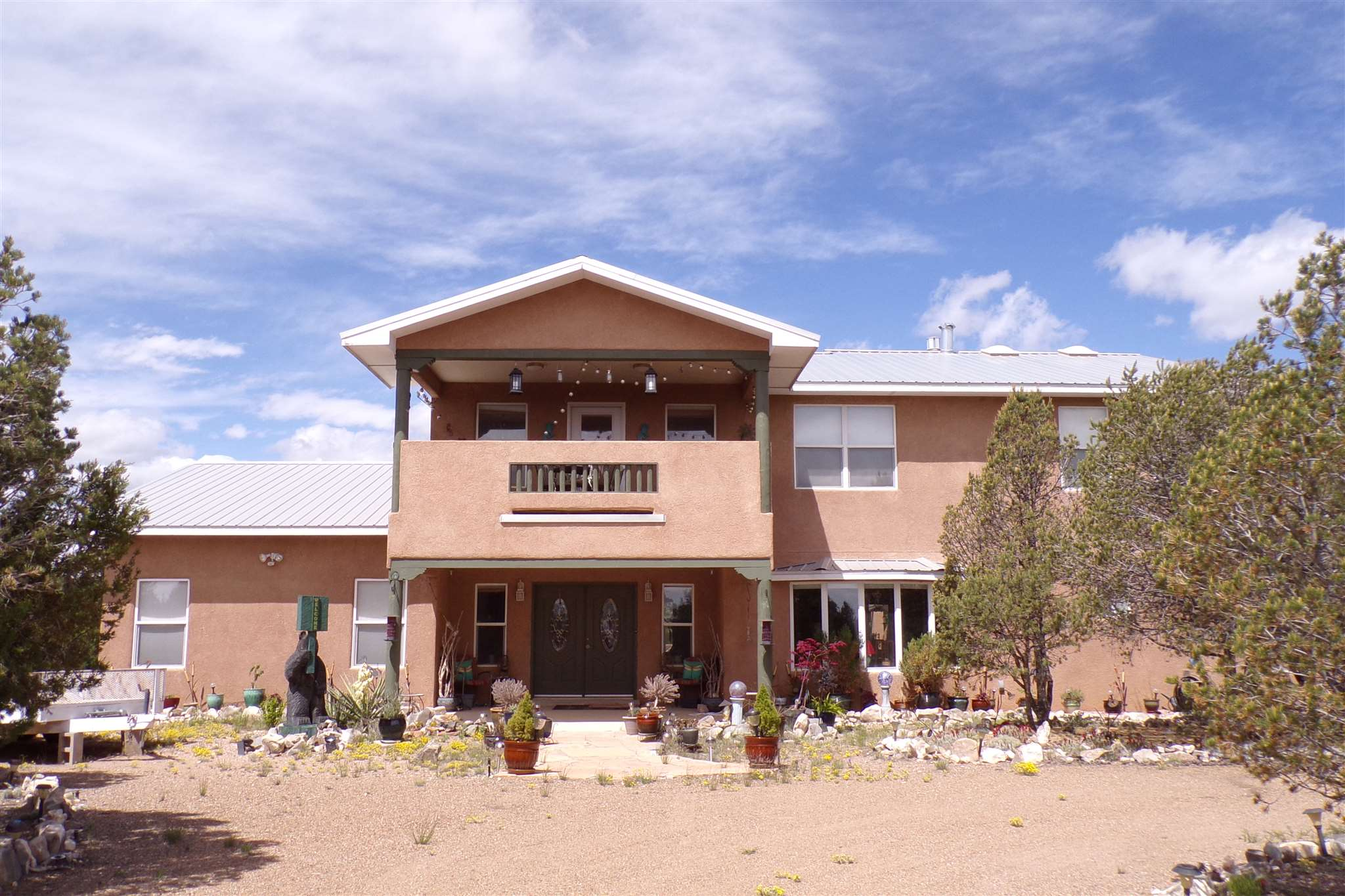 This Edgewood, NM home has 2970 sf of heated space and 3395 sf under roof. The home sits on 2.25 acres and is located just 30 minutes from Albuquerque making this an easy commute to the city via the I40 corridor. Santa Fe is about an hour's drive for awesome food, fun, culture and art. The home is 3 bedrooms with a study that could easily serve as 4th bedroom. The master suite is spacious with a large walk-in closet. Bedrooms 2 and 3 are upstairs separated by a Jack & Jill bath. The upstairs loft could be used as office space or a second living area. The balcony offers a lovely view of the Estancia Valley. The kitchen features top-of-the-line appliances, island, eating bar and walk-in pantry. The backyard is built forentertaining with an open and covered patio with well maintained landscaping. Horses are allowed in Rancho Sandia Subdivision and the acreage offers plenty of space to build a nice equine area. Come out to the East Mountains where the living is easy and spacious.