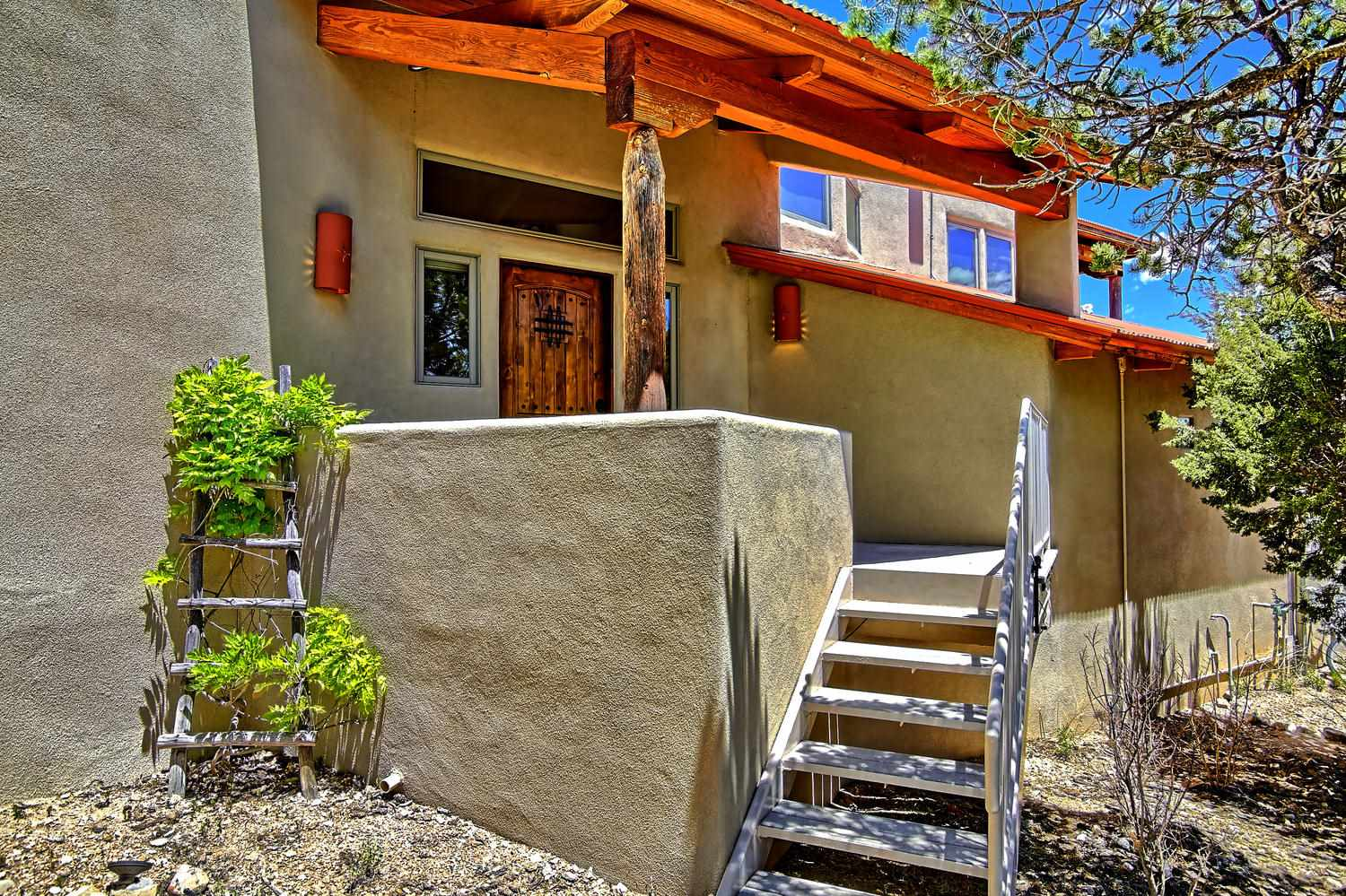 OPEN HOUSE! Saturday - 8/10, from 1 to 4 PM. Awe-inspiring, panoramic mountain vistas are yours from this captivatingly custom home featuring a modern twist to SW styling. Designed and built by H. Glen Murray, this home offers two spacious living and dining areas, a flowing floorplan, perfect for entertaining, and a magical outdoor courtyard, patio, and decks. Broadband Internet at 25 mbps. Separate owners suite with 2-way fireplace, fabulous bath, and private deck for mountain viewing, star gazing, and relaxing with all of nature's nuances. Matchless Country Beauty!
