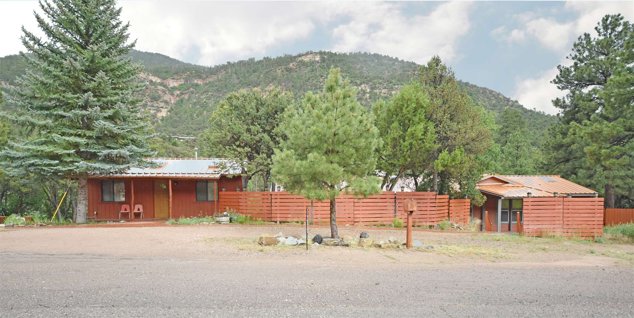 Live, work AND play all in the same place on this great property in the Jemez Mountains! This riverfront lot offers an 1820 sq ft residence and a 430 sq ft studio with highway frontage. Located right outside of Jemez Springs off of Highway 4, this spot is always accessible and is the perfect location for your home-based business or studio. It is currently operating as a successful chiropractic clinic. Brand new roof with transferrable warranty. Upgrades include newer appliances, washer and dryer, hot water heater & carpet. The open concept floorplan makes this home nice and comfortable and the skylights bring in plenty of natural light. Walk out onto the back deck that looks right down at the serene Jemez River. Terrific views all the way around. It doesn't get much better than this!