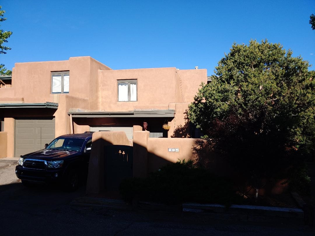 Ideal location for that 2nd home in Santa fe, an easy walk down to the plaza,    dining, art galleries, shopping,, Kiva fire place for cool evenings , and 2 generous bedrooms upstairs  main level contains a 3/4 bath beams tils and a great little dining area  Put this condo on the Must see list..