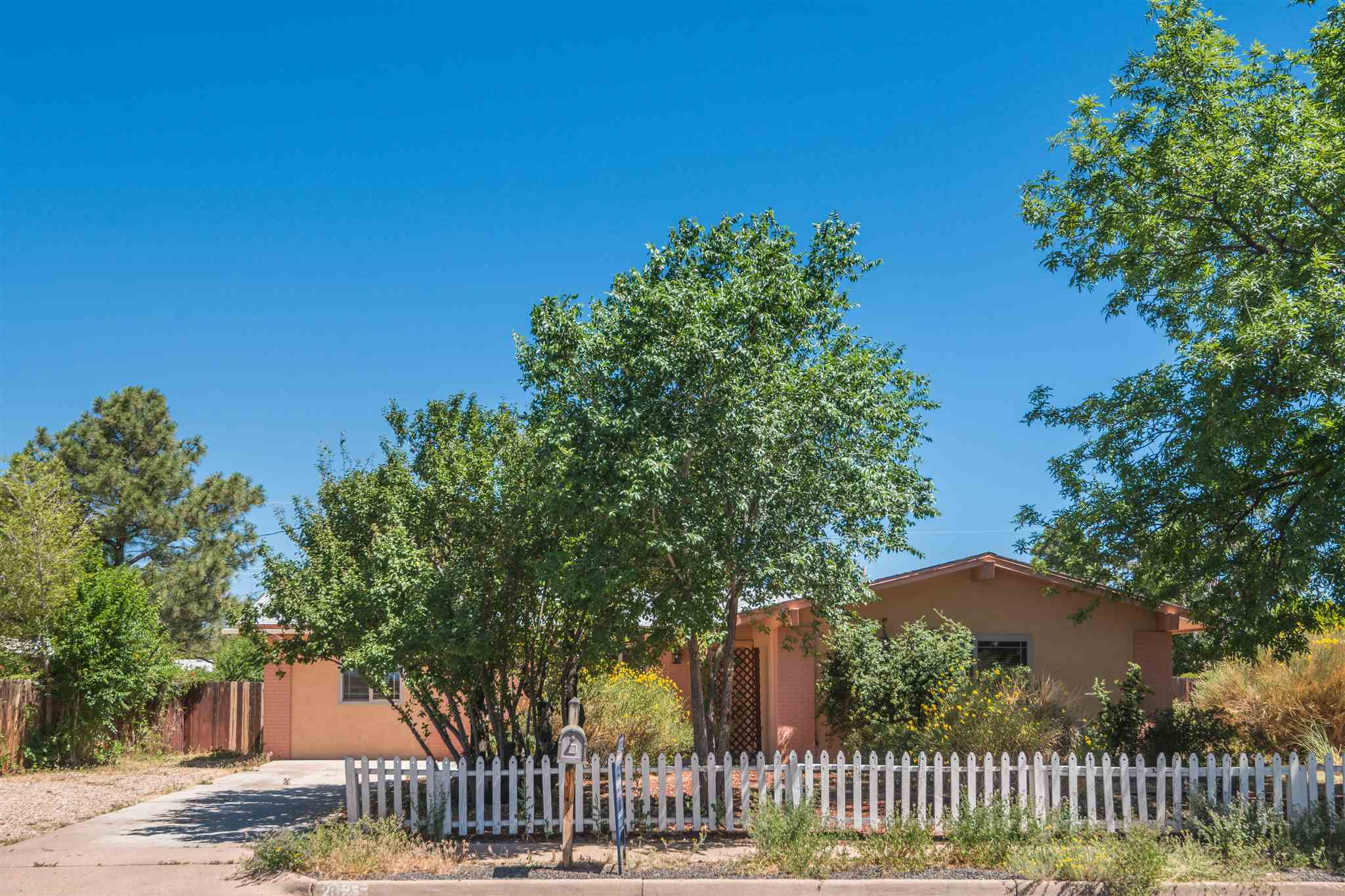 "This beautiful 3 bedroom, 3 bath updated Bellamah home located in the Vista Del Sol neighborhood is centrally located to shopping and schools. Offers convenient access to all things ""Santa Fe"". Recent remodel, new roof, new carpet, new paint, new tile throughout."