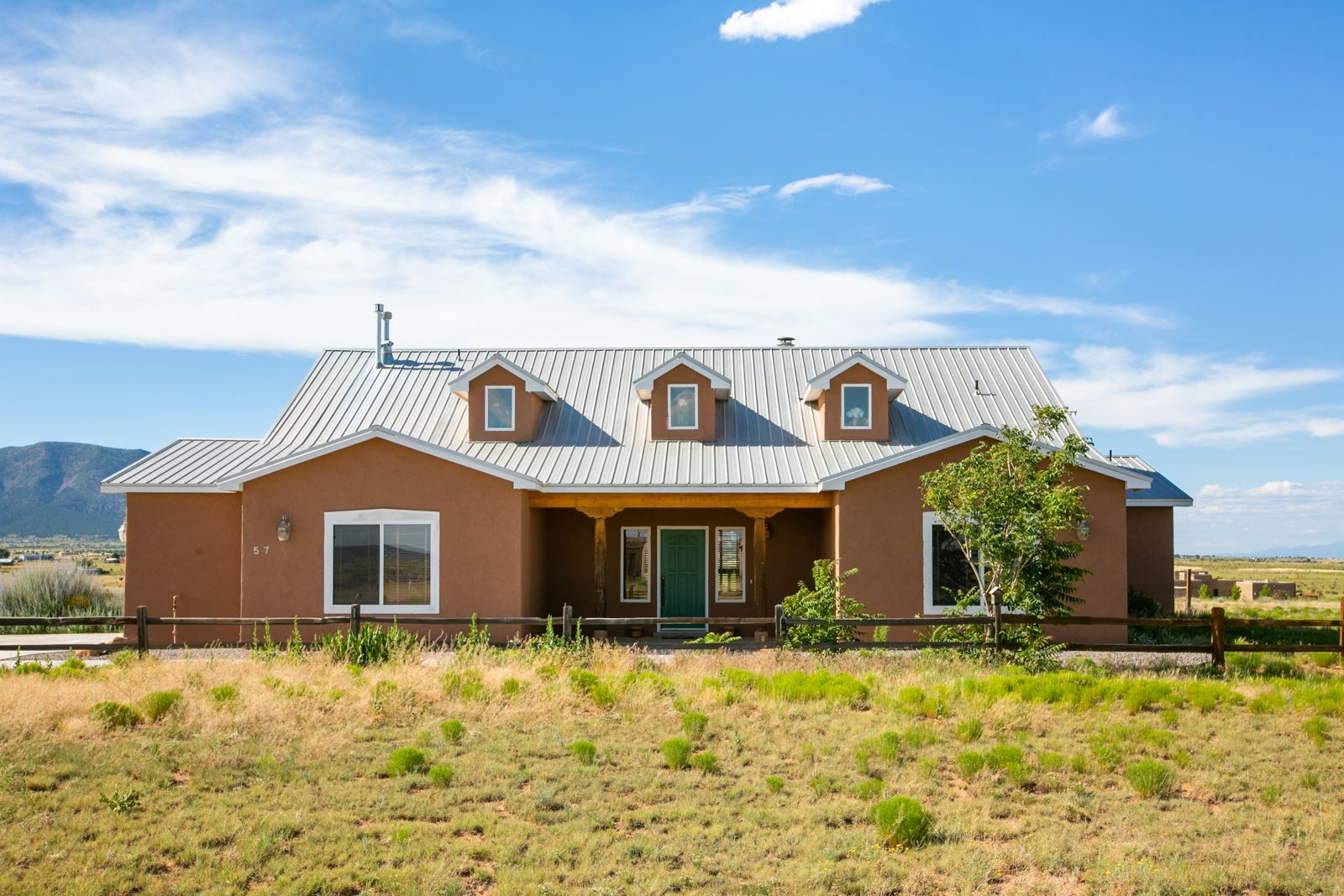 Welcome to this Bright, Beautiful, Single-Story Home in Edgewood, NM! Nestled on 2 Full Lush Acres, 57 High Meadow Loop offers Peace, Serenity, and Scenic Beauty while remaining Close to Everything that New Mexico has to offer! *Stunning Mountain Views for Miles!* This Home features an Open Floor Plan and Large Kitchen with Island and Plenty of Storage. Let a Custom, Stacked-Stone Gas Fireplace be your Family Room's Focal Point. Spacious Master Suite with Double Sinks, Jetted Tub, Separate Shower, and Walk-in Closet. Entertain Guests on your Covered Patio with Breathtaking Views and Sunsets! Patio-Access from Kitchen and Master Suite! Pitched Metal Roof! Entranosa Community Water! Easy Access to Freeway! Close to the new Estancia Valley Classical Academy! Horses Welcome!