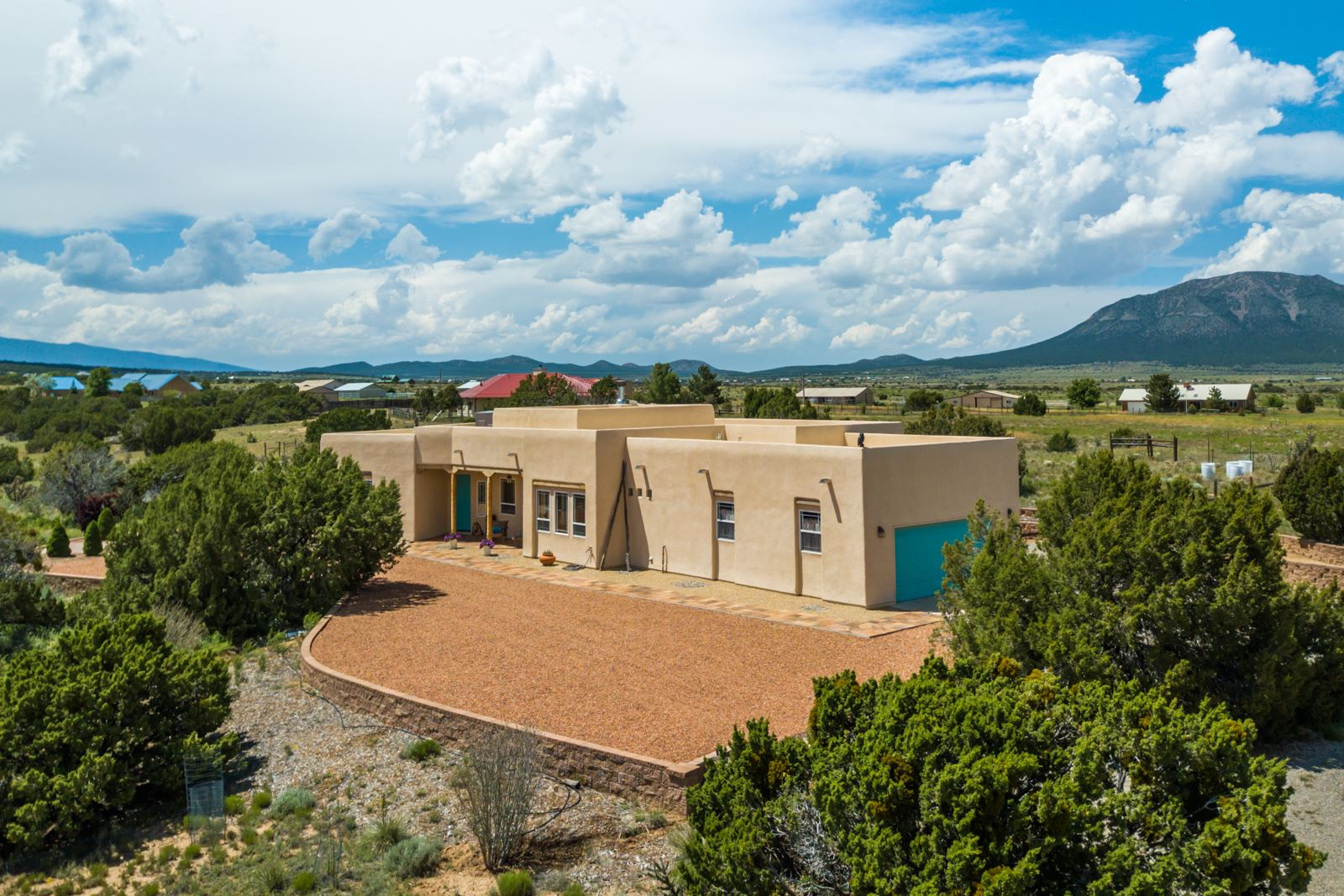 Welcome to this Stunning, Southwestern-Style, Single-Story Country Estate Nestled on 6.5 Pristine Acres in Edgewood, NM! 19 Hawkeye Road features a New TPO Roof (with Transferrable Warranty) and New Stucco on both the Main Home and the Studio/Workshop! This Home offers an Open Floor Plan, Lots of Natural Light, and Breathtaking Mountain Views for Miles! Graced by Soaring Tongue & Groove Wood Viga Ceilings and a Wood Burning Kiva Fireplace, 19 Hawkeye features an Updated Kitchen with Granite Countertops, Stainless Appliances, Island, and Breakfast Nook. Luxurious Master Suite with Double Sinks, Jetted Tub, and Separate Shower. Newer Detached Building on the Property can be an Art Studio, Workshop, or Storage Area. 4 Garage Spaces! 2-Car Garage at Main Home, 2-Car Tandem Garage at Casita! Come and see this Home today!  Other Features: Gated Entry to Property. Patio Access from Master Suite and Living Area. Entranosa Community Water! Generac 15kw Generator Included! All Appliances Included! Easy Access to Freeway! Close to the new Estancia Valley Classical Academy Public Charter School!
