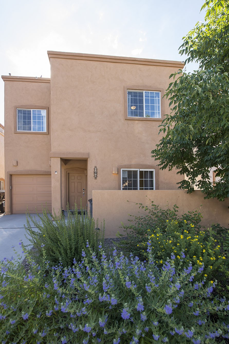 This 4 bedroom 4-1/2 bathroom home is wonderfully maintained and a simple 10-15 minute drive to anywhere in Santa Fe and 35 minutes to Bernalillo. Fully energy efficient with 23 solar panels for an average monthly bill of $8.   This home has 3 bedroom enSuites with the master bedroom opening onto a beautifully appointed 400 sq. foot East facing deck.  Step out to the deck with a low maintenance yard to sit back and enjoy the fantastic views of the Sangre de Cristo mountains! Backing up into a greenbelt, this property is especially quiet and is in close proximity of three parks and walking trails.