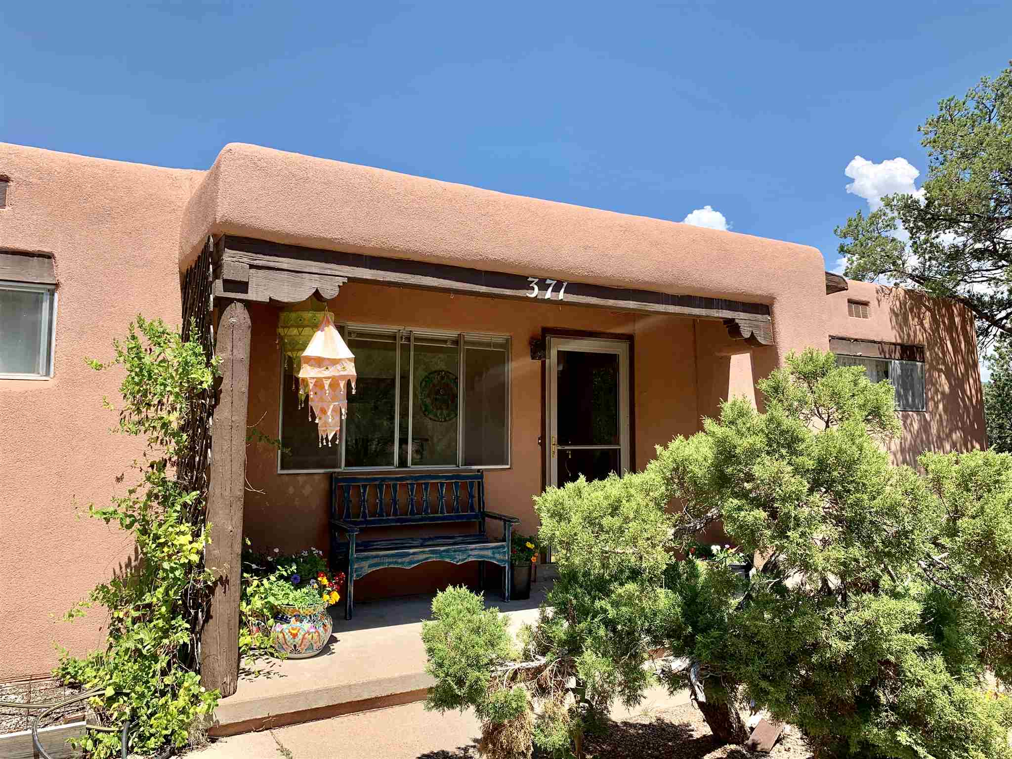 Wonderful opportunity to own in central Santa Fe. Close to Museum Hill and shopping. The entrance to the Botanical Garden path is just across the street from the property on Old Pecos Trail. Enjoy mountain views and a 1.73-acre lot. The home's original condition has been well maintained and is looking for a new owner to put their own special touches in place. Don't miss out on this fabulous property!