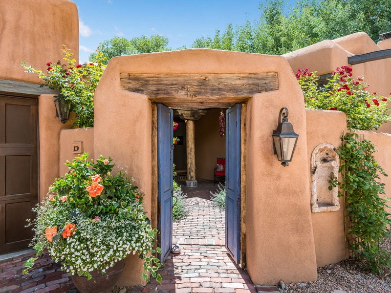 IMAGINE!  THE BEST OF THE BEST IN SANTA FE'S HISTORIC DOWNTOWN AREA.  This Eastside home and guest house is an absolute WOW.  Set off San Antonio - on many people's favorite sleepy street - this pinnacle of Historic Eastside living is what echoes Santa Fe whenever you think about living here with sophistication and style. You will find this tucked-away oasis consisting of a divine adobe/frame home plus guest house circled by delightful gardens with towering quaking Aspen trees, ambling roses, and exquisite landscaping. This property enjoys unparalleled appointments and is located in the San Antonio Compound Condo.  Glorious courtyards, water feature, spa, 2 car garage, parking ..what more could you possibly want?  More photos to come.