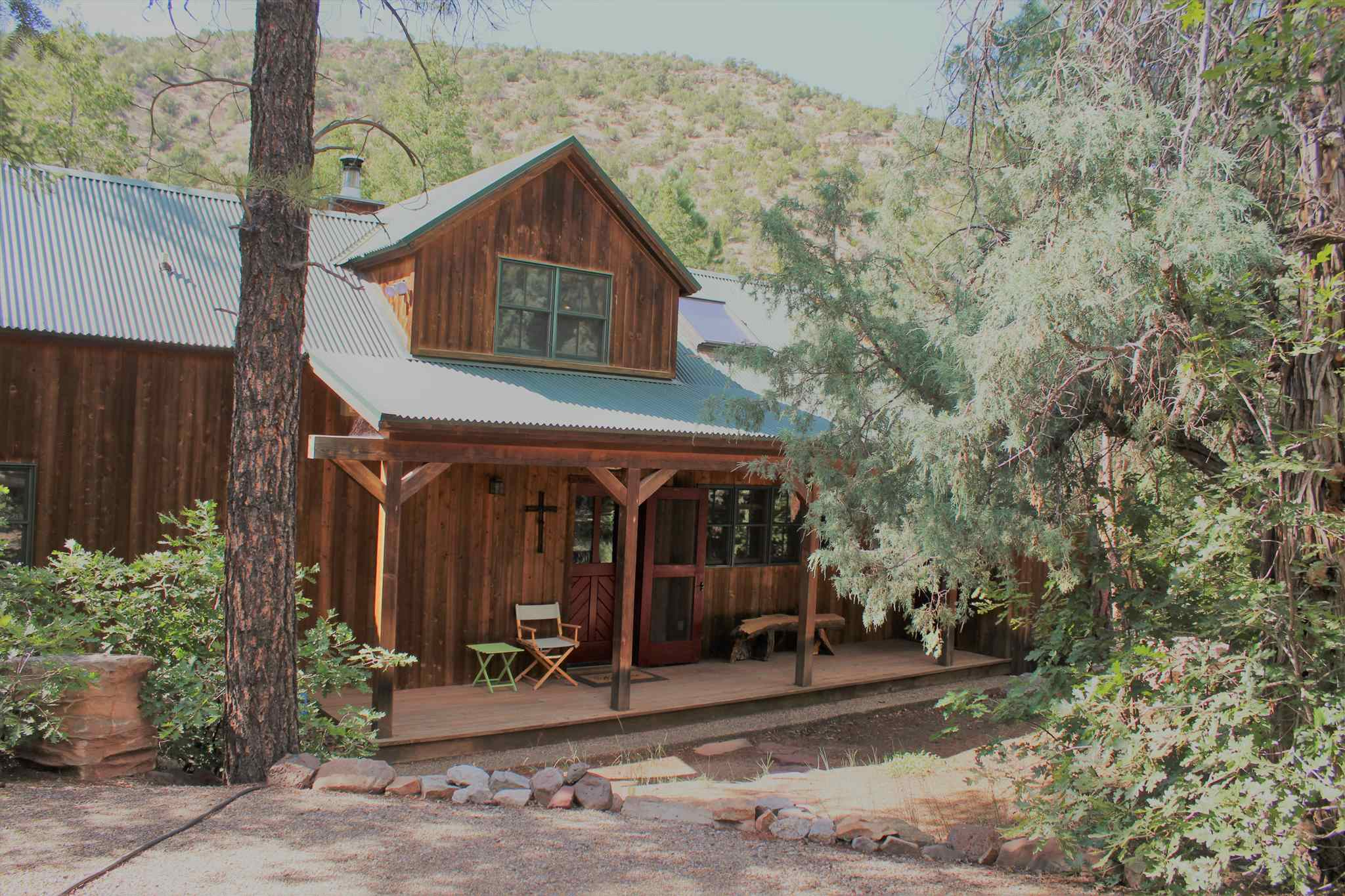 Unbelievable Riverfront GEM. Sit on the screened or open deck; your choice, but from either you will be soothed by the sound of the gurgling stream and the chirping birds. Lovely sitting area right beside the river for peaceful moments to reflect or a fishing excursion. Inside, nothing but gorgeous wood everywhere you look. Stunning solid wood floors made of Longleaf Heart Pine, floating subfloor with radiant heat providing 7 separate zones to heat only where necessary. Solid wood doors fabricated in Placitas, Interior walls and ceiling all 2'' gorgeous tongue and groove. Eagle wood windows and sliders. Top of the line sub-zero built in refrigerator, impressive Viking freestanding stove. ALL Unbelievably beautiful furnishings stay with home! Please watch VIRTUAL TOUR