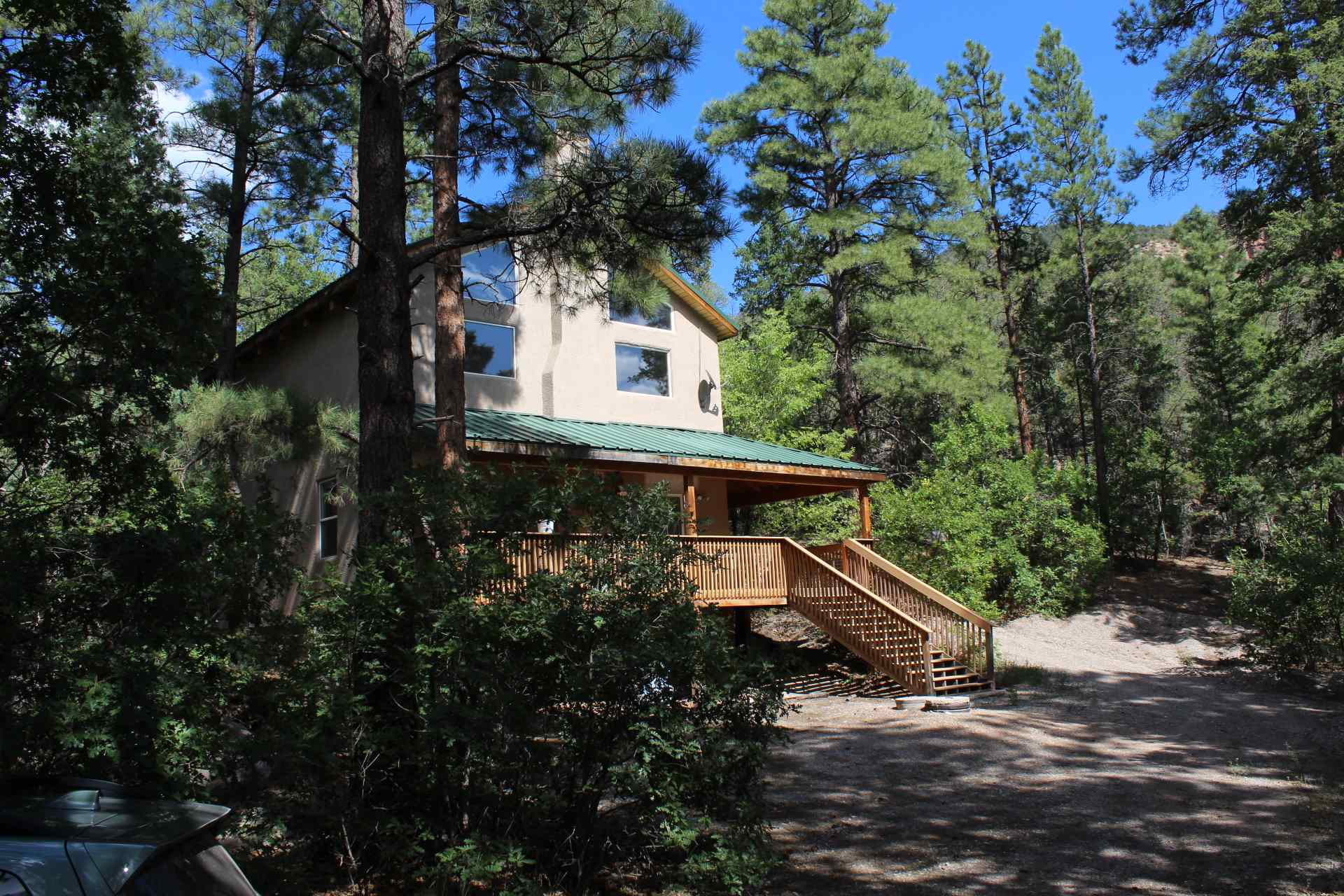Now here is a listing to see and HEAR!! Nestled right down along the Jemez River. With OVER 300 FEET of RIVER FRONTAGE the sound of the river will ABSOLUTELY become a delightful part of every day and every night!! Spacious open living area has floor to ceiling windows and 2 sets of sliders to the covered composite deck. Well arranged, efficient kitchen has a great eat-at bar. Good-sized bedroom, Office and full bath on lower level. Upper level is HUGE master with comfy sitting area, full-bath & large walk-in closet. Loft is a fun den/rec room, work/office or craft area. 1.1 acre lot is nicely forested with trails and plenty of hammock and gazebo spots! City water and county maintained road. There aren't too many available with this kind of amazing river frontage!! Don't let this one slip away!