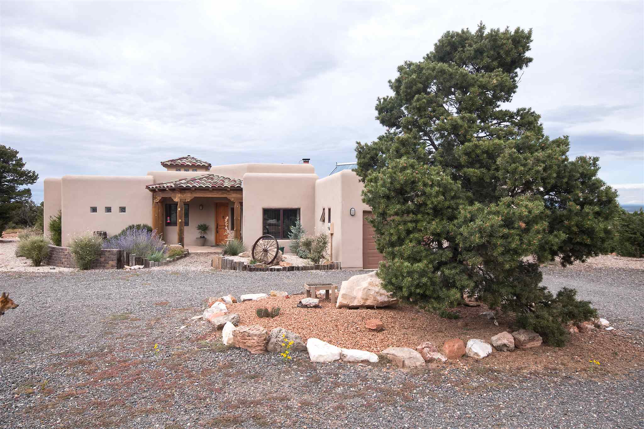 """Deer Canyon Preserve horse property surrounded by nature with sweeping views of the Manzano Mountains and Chupedero Mesa. This special conservation oriented community comprises over 18,000 acres of which half are protected by conservation easements. There miles of hiking and riding trails and wildlife abounds. This custom built house is super energy efficient and offers open concept living with multiple entertainment spaces both indoors and out. Brick floors throughout and Southwestern design with vigas and wood accents. Check out this special place to call home. This is a perfect retirement home, second home or """"work from home"""" spot. Set up an appointment to see it today"""
